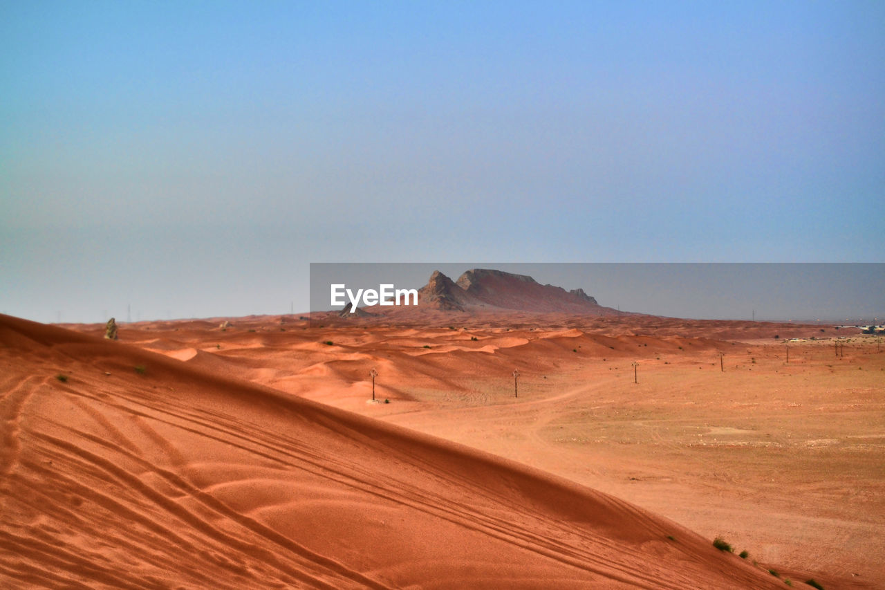 desert, landscape, scenics - nature, climate, environment, sky, arid climate, land, tranquil scene, non-urban scene, beauty in nature, sand, nature, tranquility, remote, clear sky, day, sand dune, no people, copy space, outdoors, atmospheric, eroded