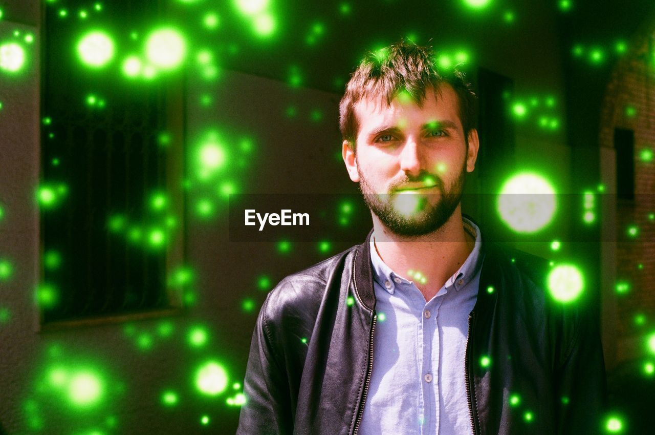 one person, front view, illuminated, green color, young adult, young men, night, nightlife, nightclub, real people, casual clothing, facial hair, indoors, portrait, adult, emotion, beard, waist up