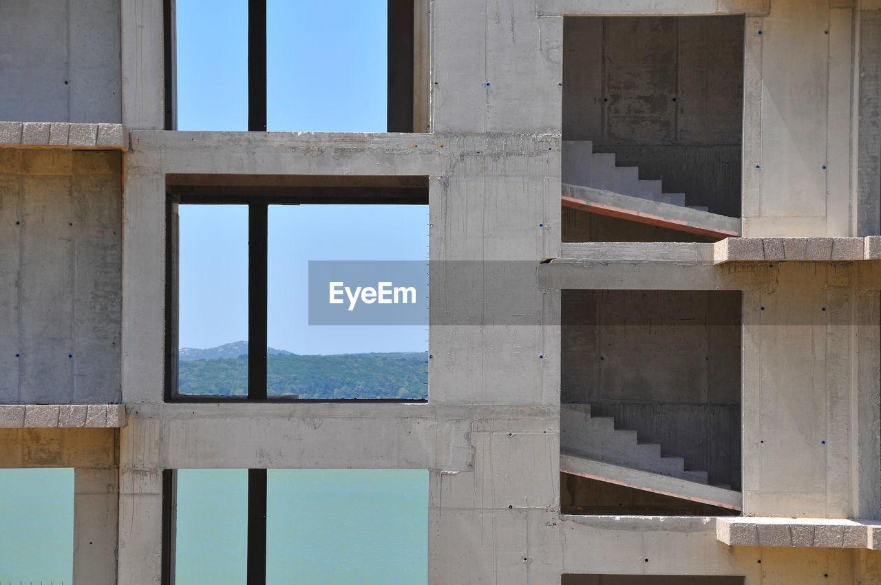 BUILDING SEEN THROUGH WINDOW