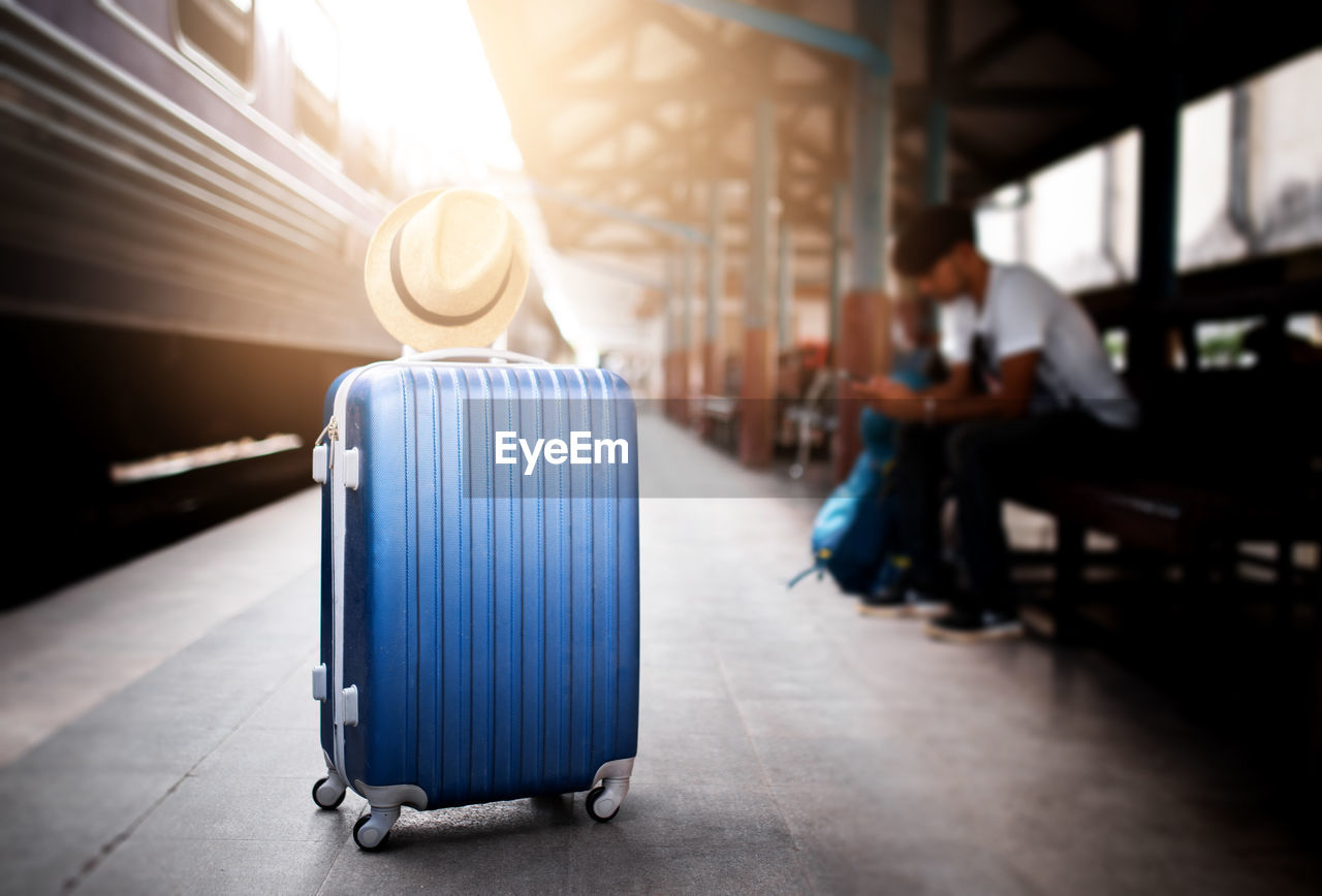 Close-up of luggage on railroad station