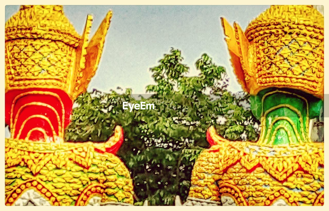 yellow, statue, no people, multi colored, sculpture, close-up, outdoors, day, flower, beauty in nature, tree, nature, freshness, sky