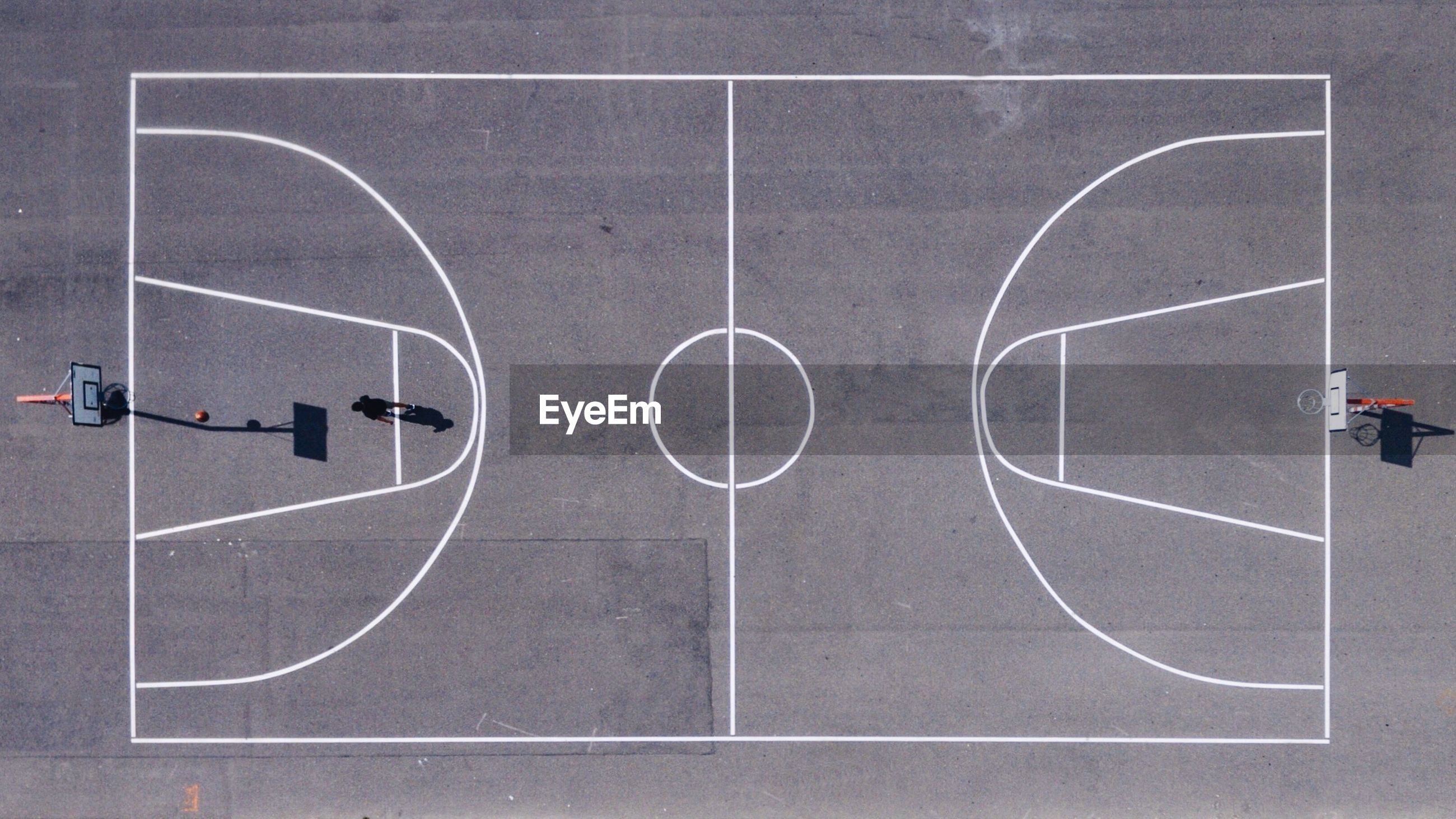 Directly above shot of athlete playing at basketball court