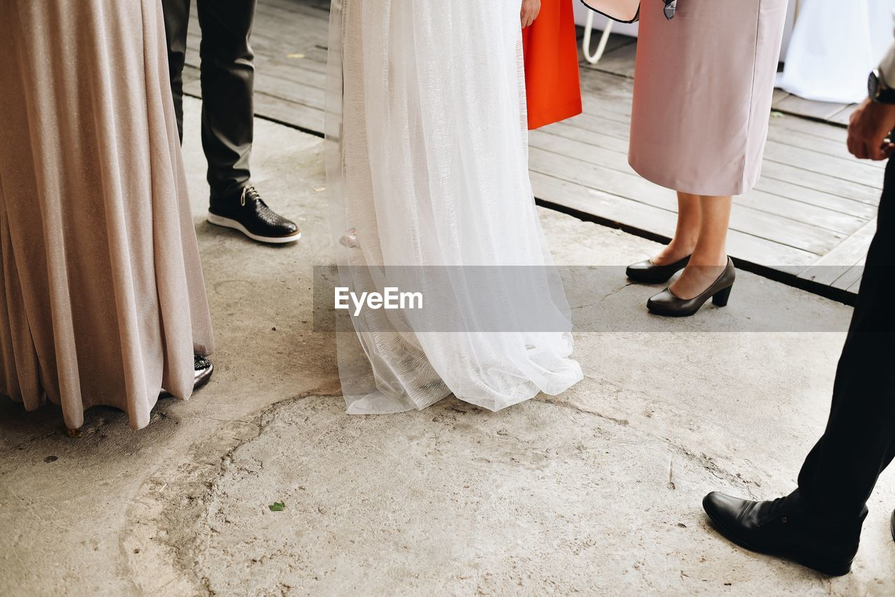 Low section of people at wedding party standing on floor