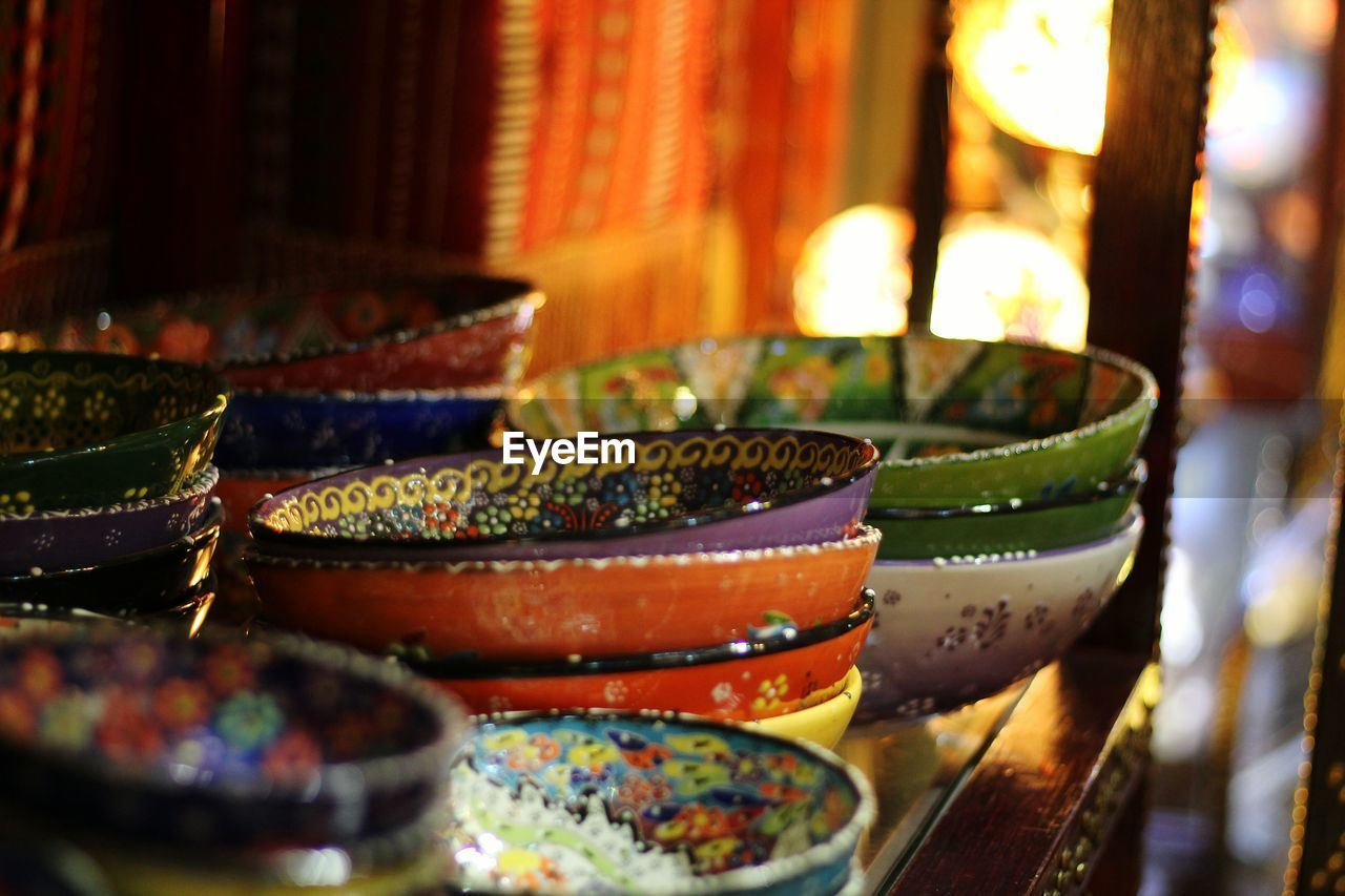 selective focus, indoors, no people, multi colored, bowl, choice, food and drink, variation, retail, close-up, still life, food, abundance, table, for sale, large group of objects, focus on foreground, business, art and craft, arrangement, retail display