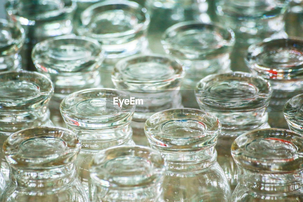 glass - material, full frame, no people, indoors, glass, close-up, drinking glass, transparent, still life, backgrounds, large group of objects, household equipment, nature, choice, water, studio shot, group of objects, container, focus on foreground, crockery