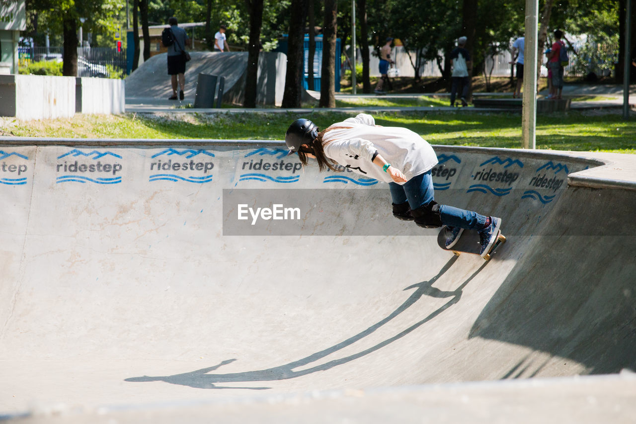sport, skateboard park, men, full length, leisure activity, day, real people, child, one person, skateboard, skill, males, boys, casual clothing, nature, motion, childhood, incidental people, mid-air, outdoors