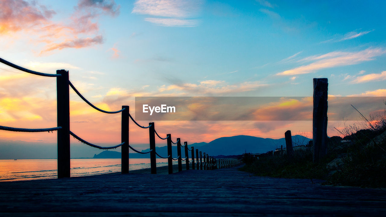 sunset, sky, nature, outdoors, silhouette, beauty in nature, scenics, tranquil scene, sea, water, no people, day