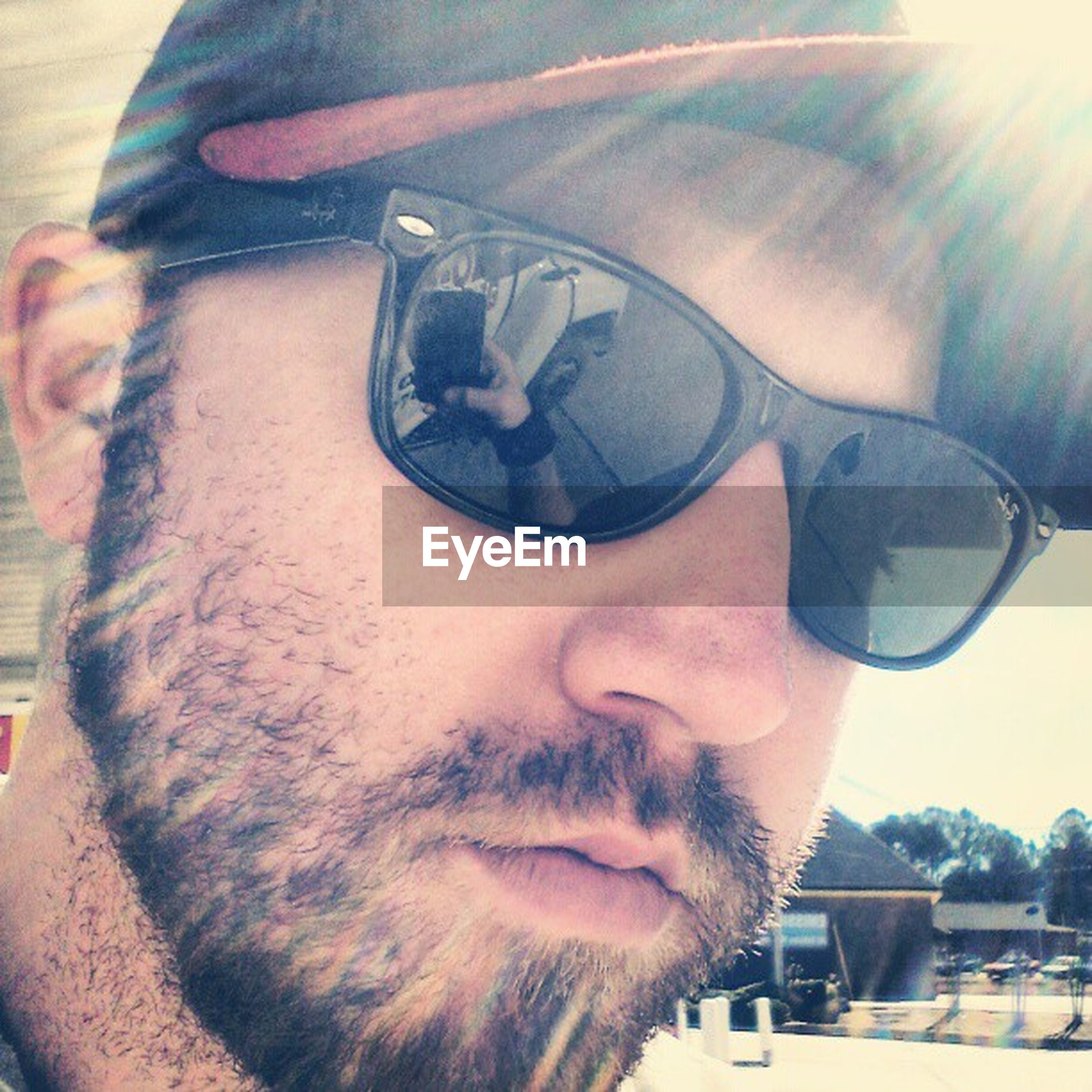 car, sunglasses, headshot, lifestyles, land vehicle, mode of transport, transportation, young adult, leisure activity, close-up, young men, portrait, person, looking at camera, beard, front view, focus on foreground, mid adult men