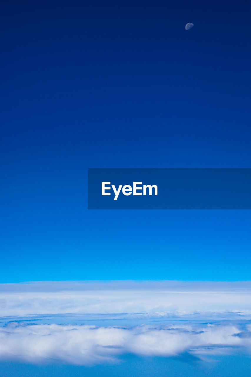 sky, blue, beauty in nature, copy space, cloud - sky, scenics - nature, tranquil scene, tranquility, no people, nature, outdoors, day, idyllic, environment, backgrounds, moon, cloudscape, majestic, low angle view, meteorology