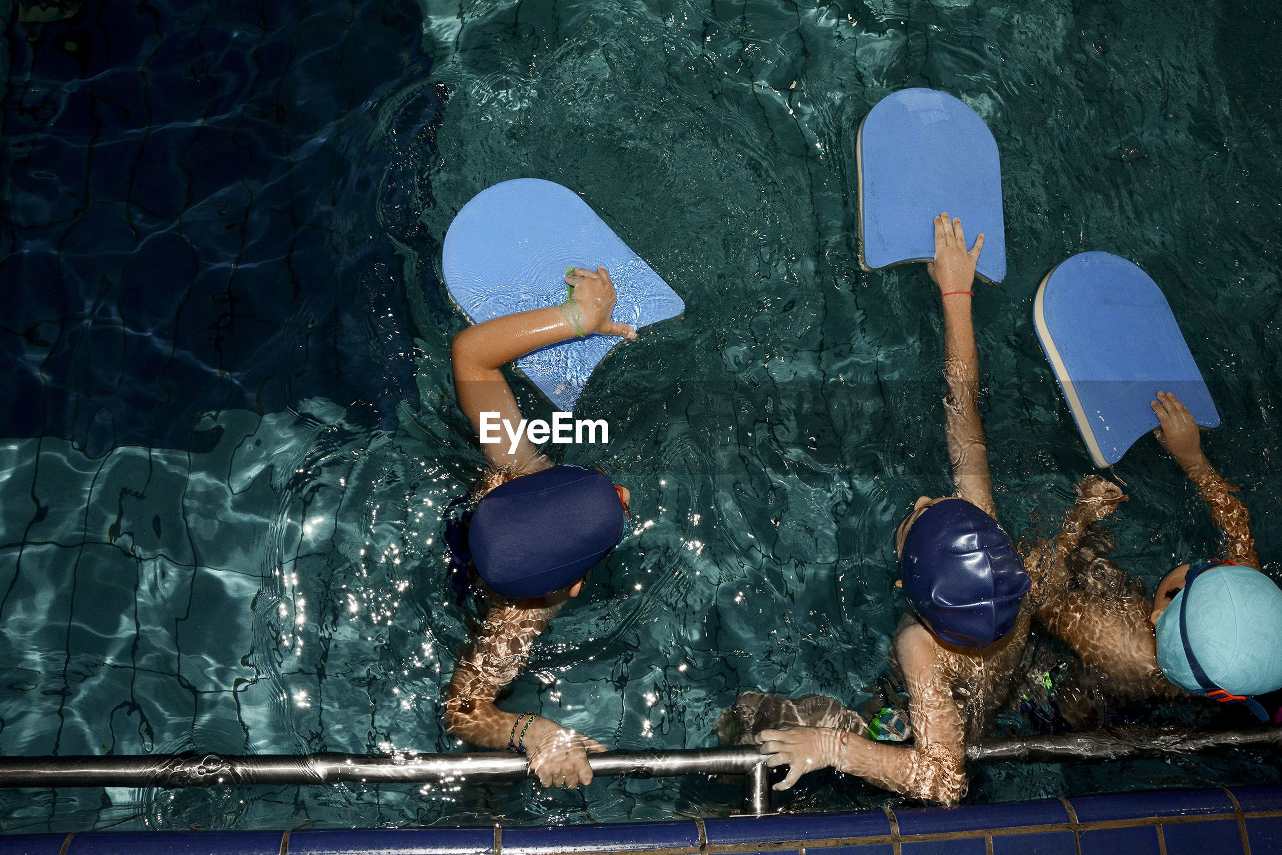 High angle view of children in swimming pool