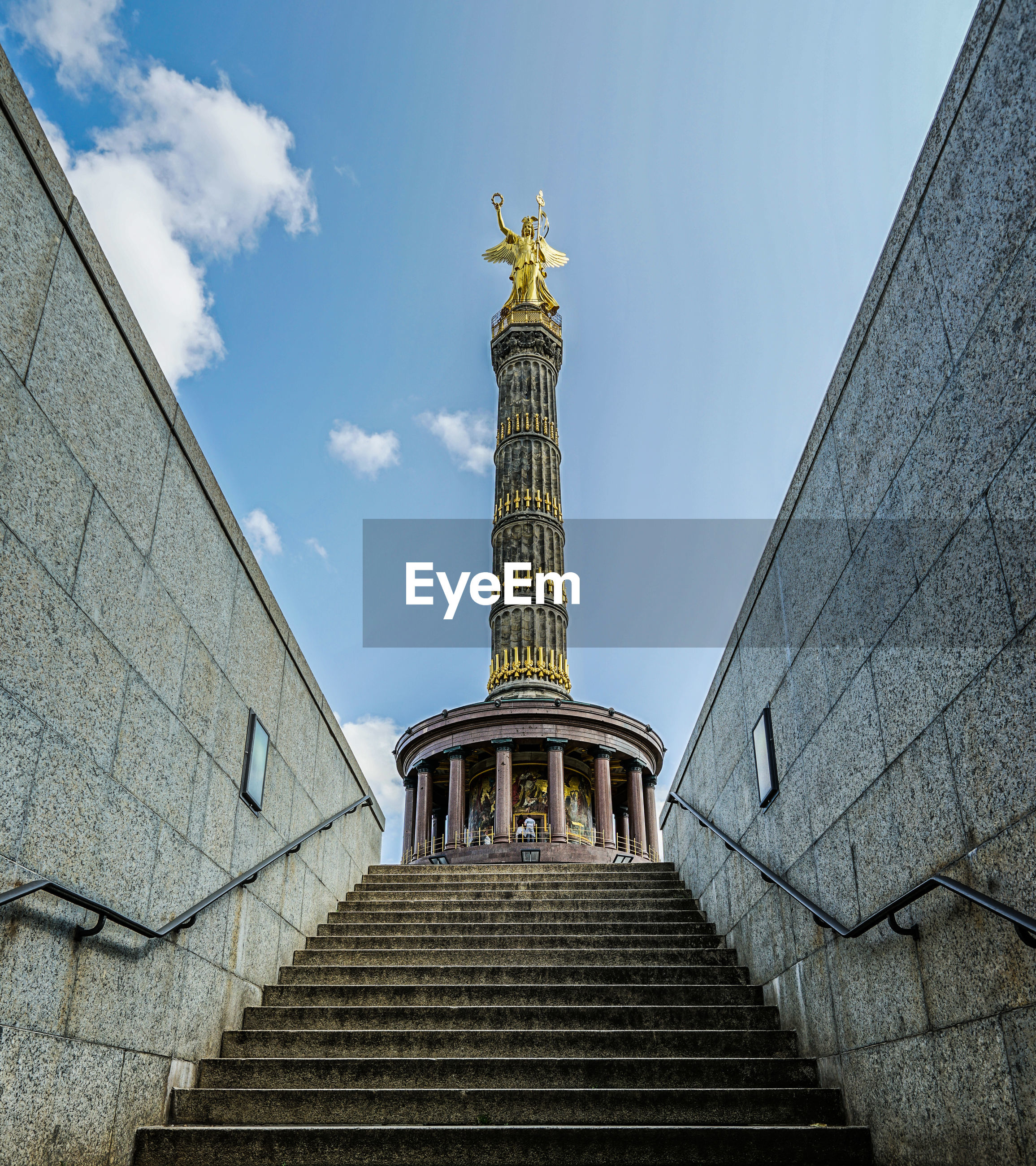 Low angle view of steps leading towards victory column against sky