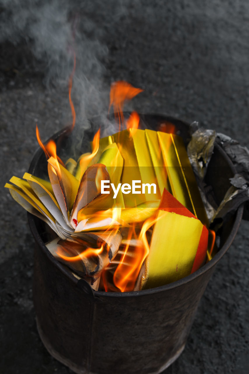 burning, fire, flame, fire - natural phenomenon, heat - temperature, no people, close-up, orange color, wood - material, nature, freshness, container, food, food and drink, outdoors, high angle view, glowing, yellow, motion, wood