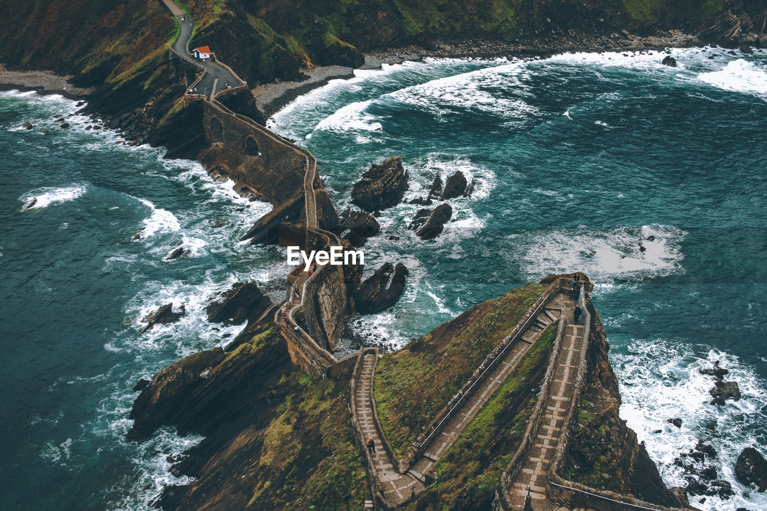 High angle view of walkway on rock formation amidst sea