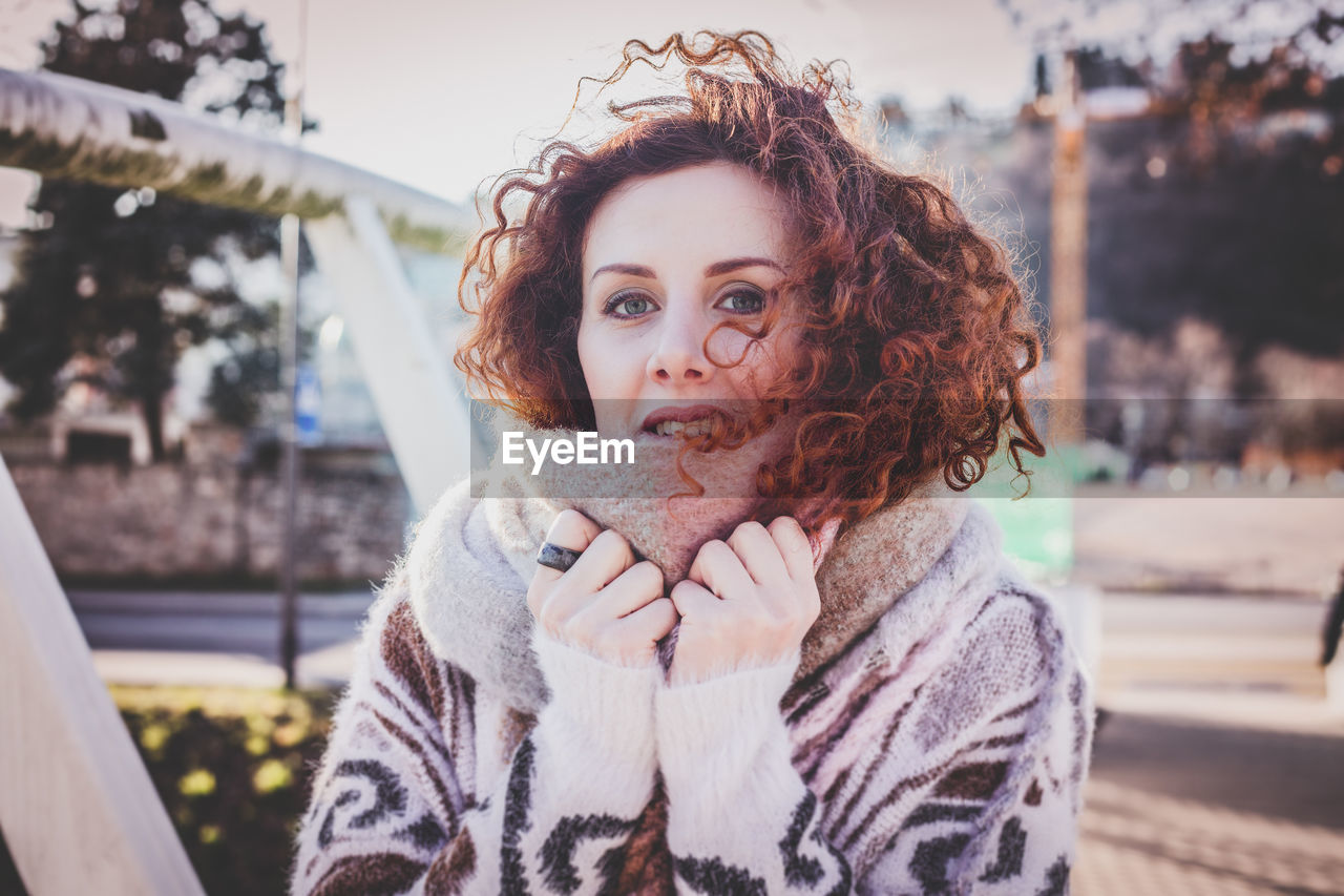 Portrait Of Young Woman In Warm Clothing Outdoors