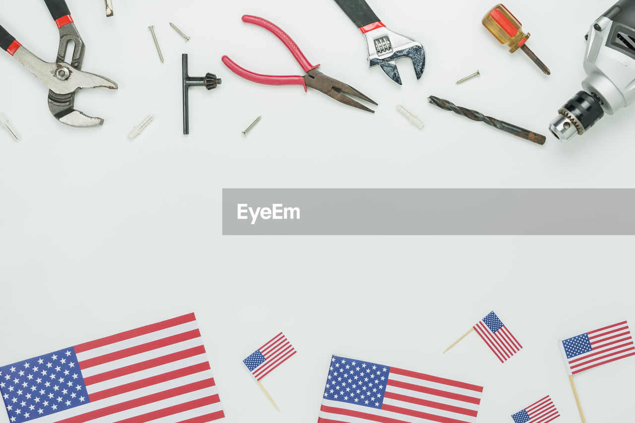 Directly above shot of work tools with american flag on table