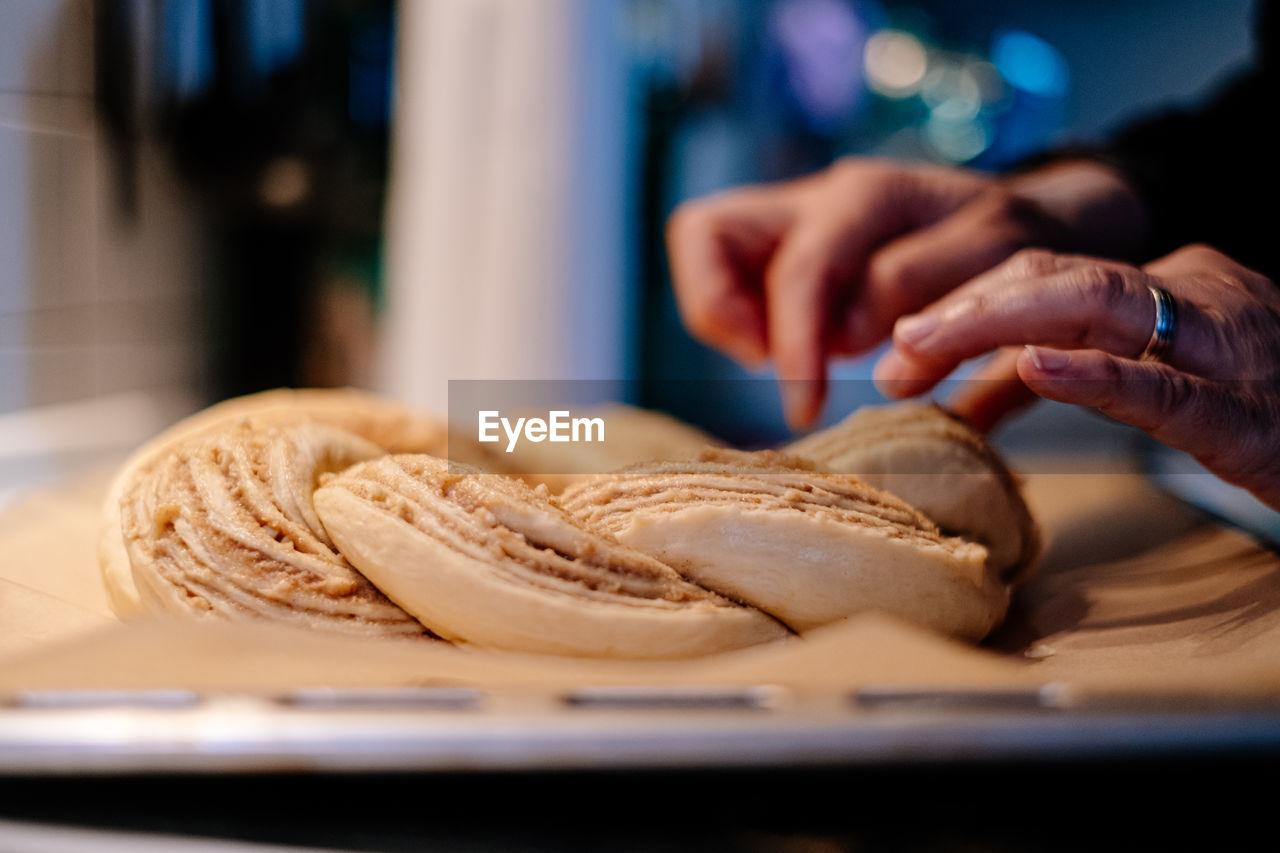 Close up of human hand preparing easter cake dough