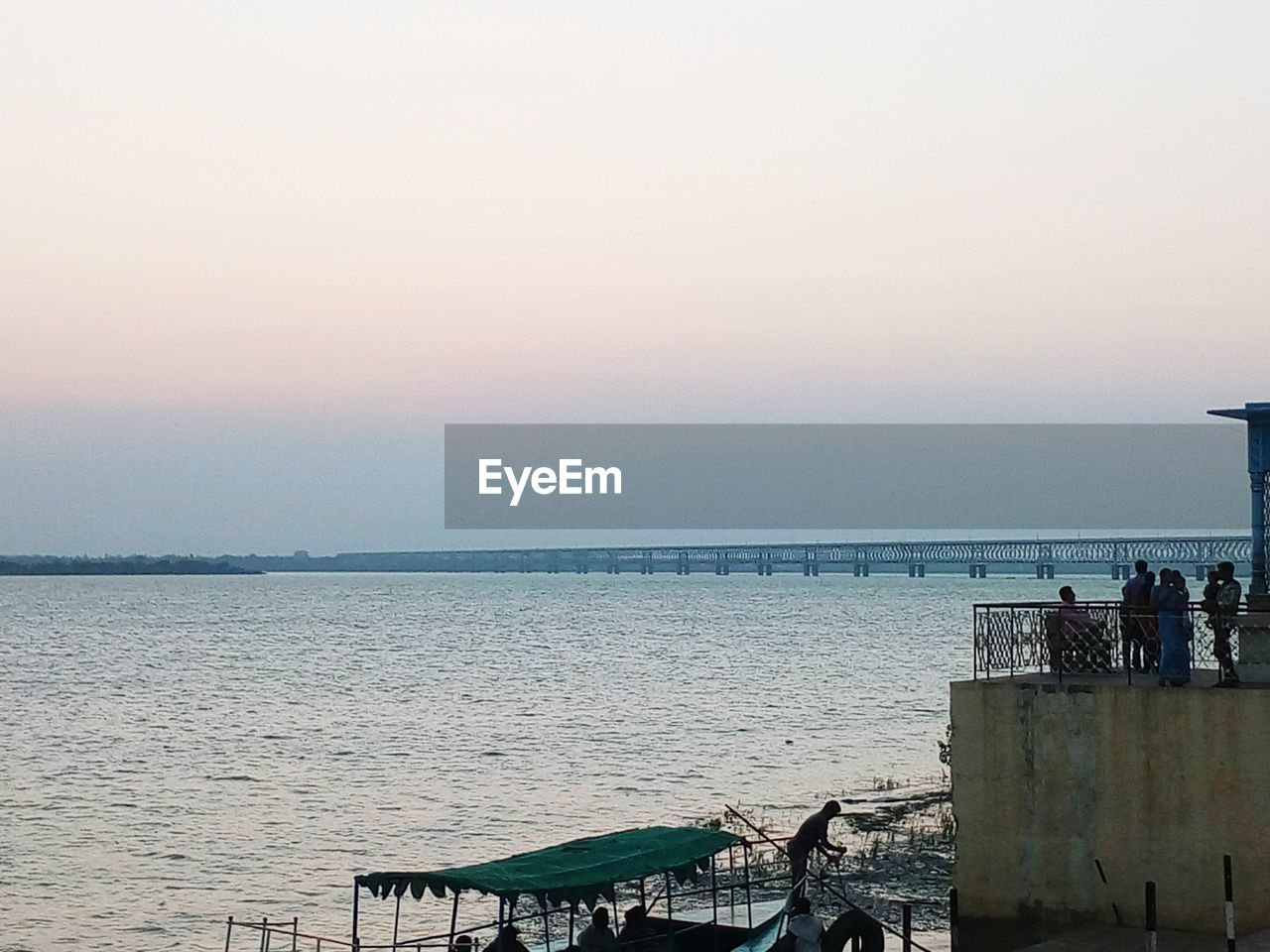 sea, water, horizon over water, nature, scenics, beauty in nature, sky, sunset, tranquility, railing, outdoors, beach, tranquil scene, clear sky, built structure, day, no people, architecture