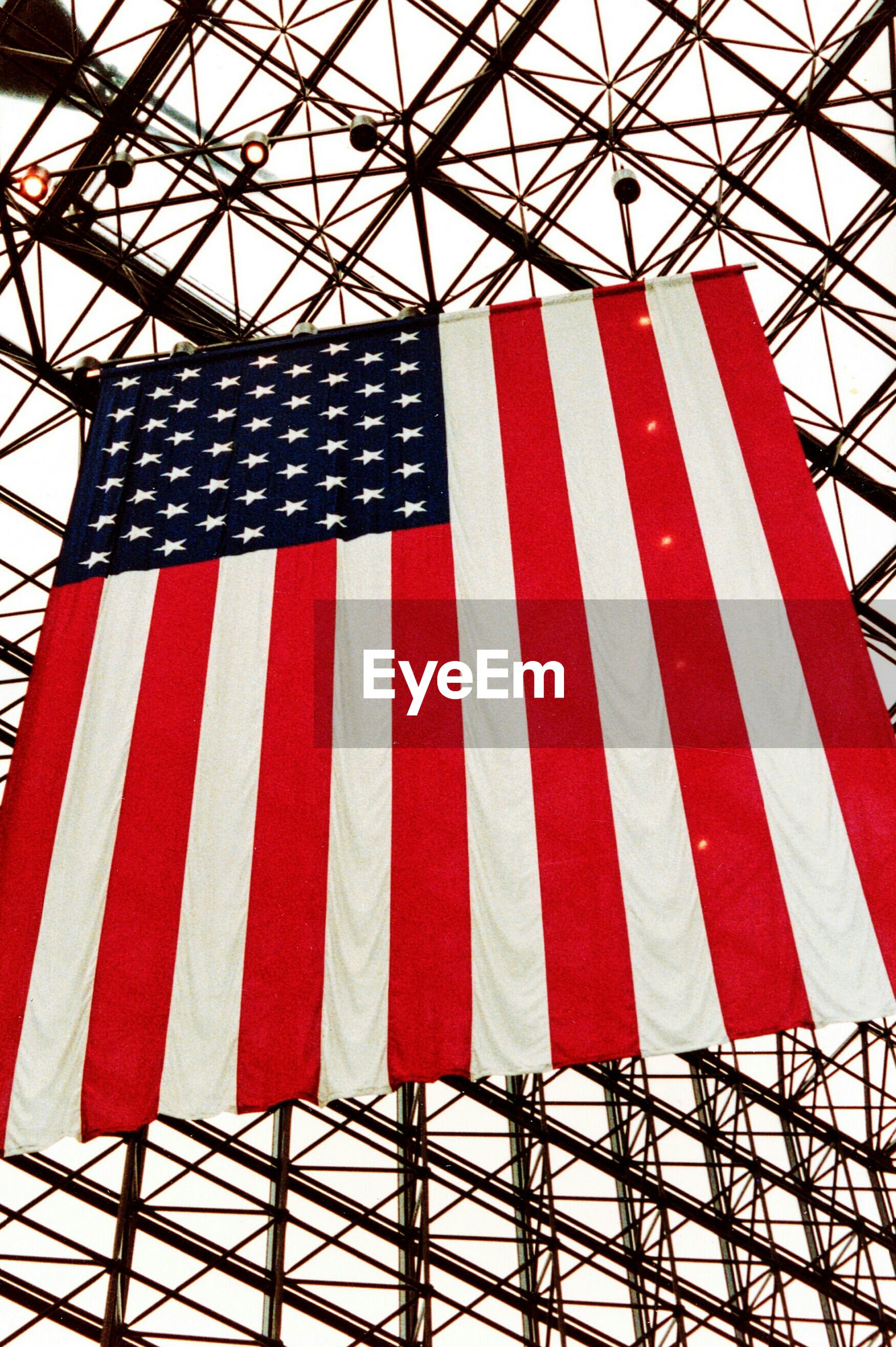 Low angle view of american flag against skylight