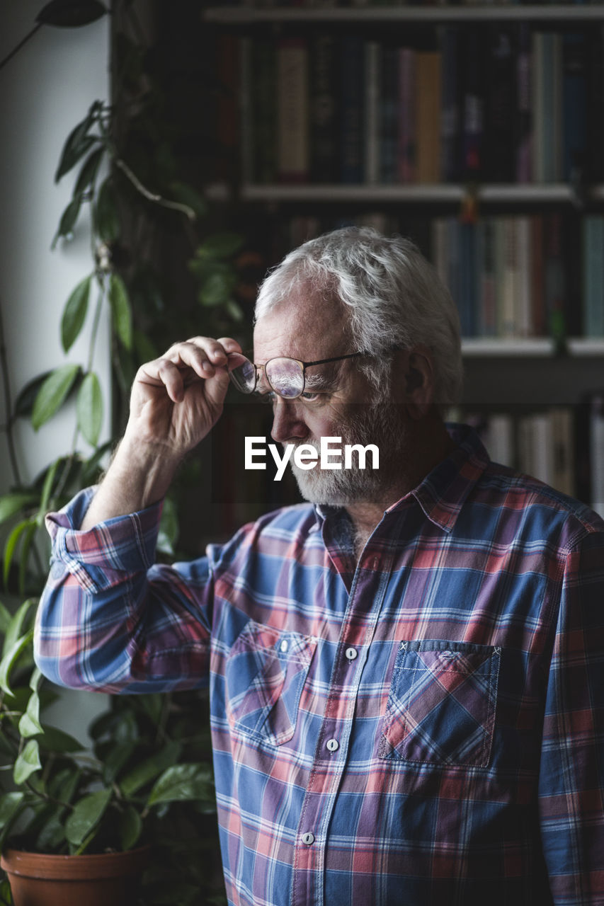 eyeglasses, glasses, real people, senior adult, one person, adult, casual clothing, waist up, lifestyles, portrait, front view, leisure activity, males, senior men, checked pattern, men, focus on foreground, indoors, mature men, white hair