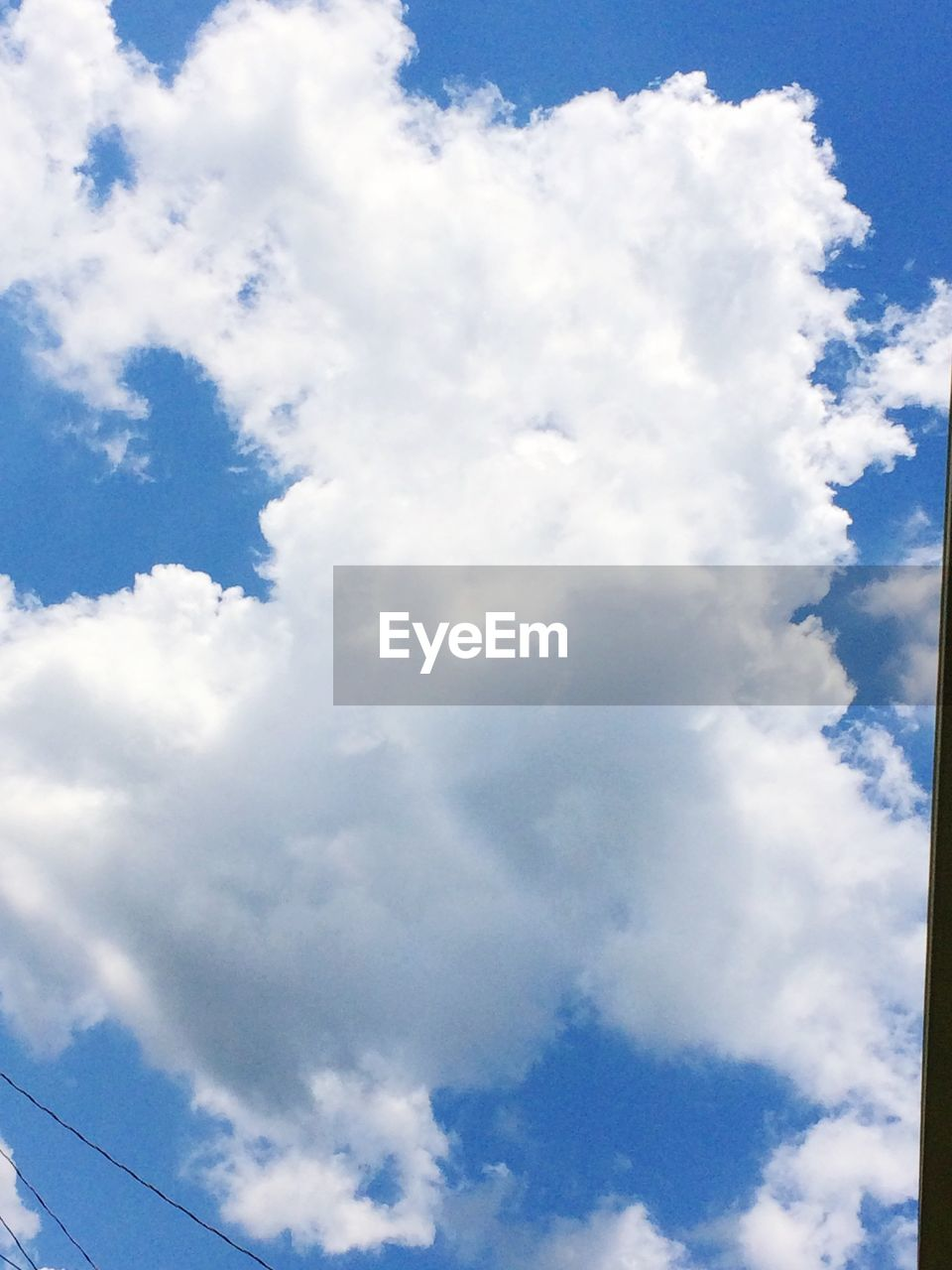 cloud - sky, sky, nature, beauty in nature, low angle view, cloudscape, sky only, day, scenics, no people, tranquility, blue, outdoors, backgrounds
