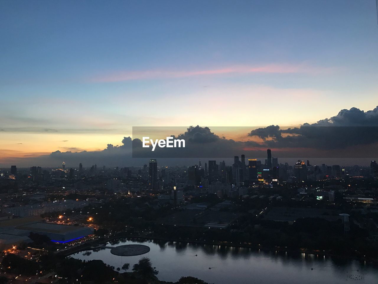 Aerial View Of City At Waterfront During Sunset