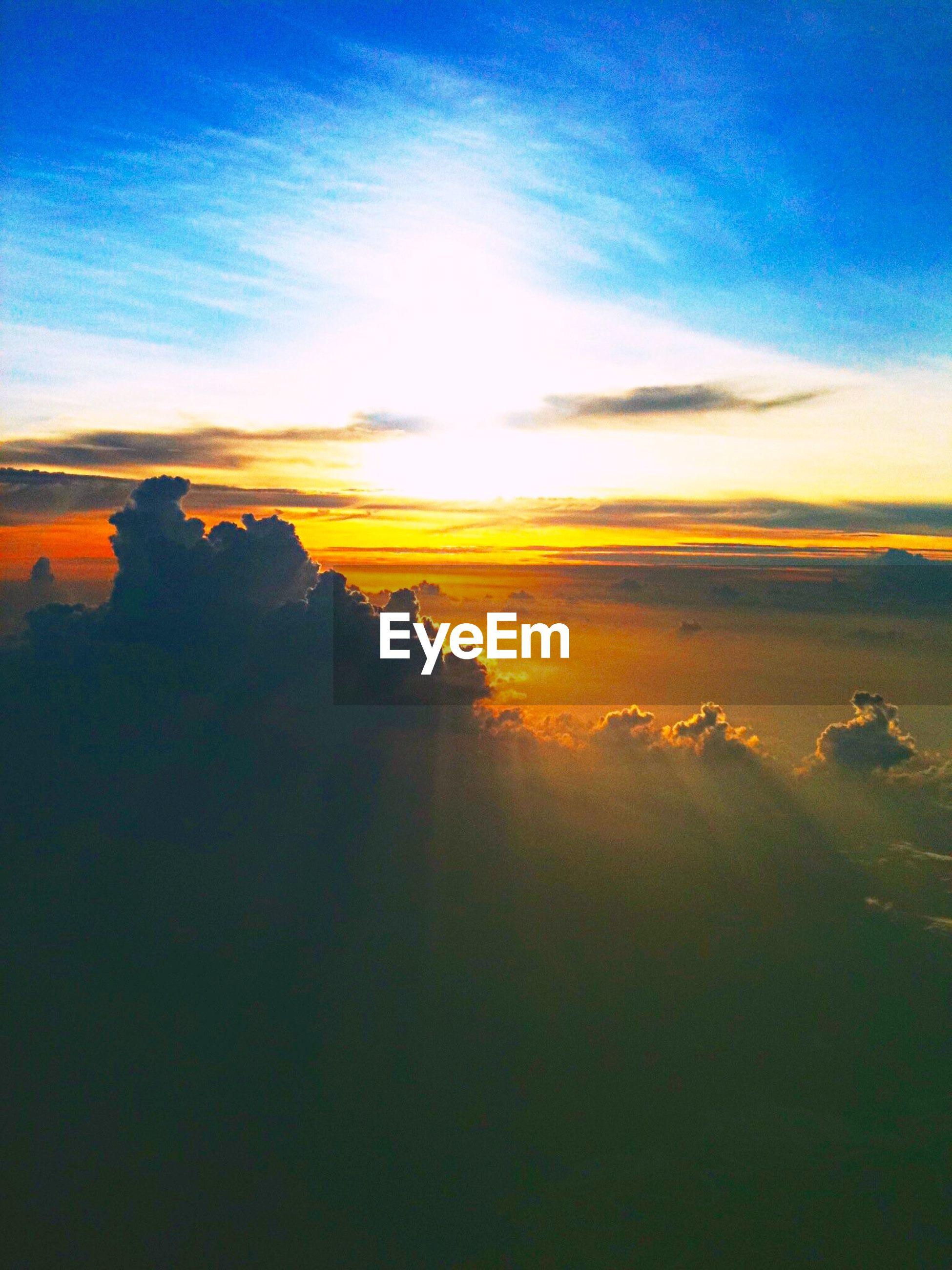 Idyllic shot of sunlight on clouds in sky