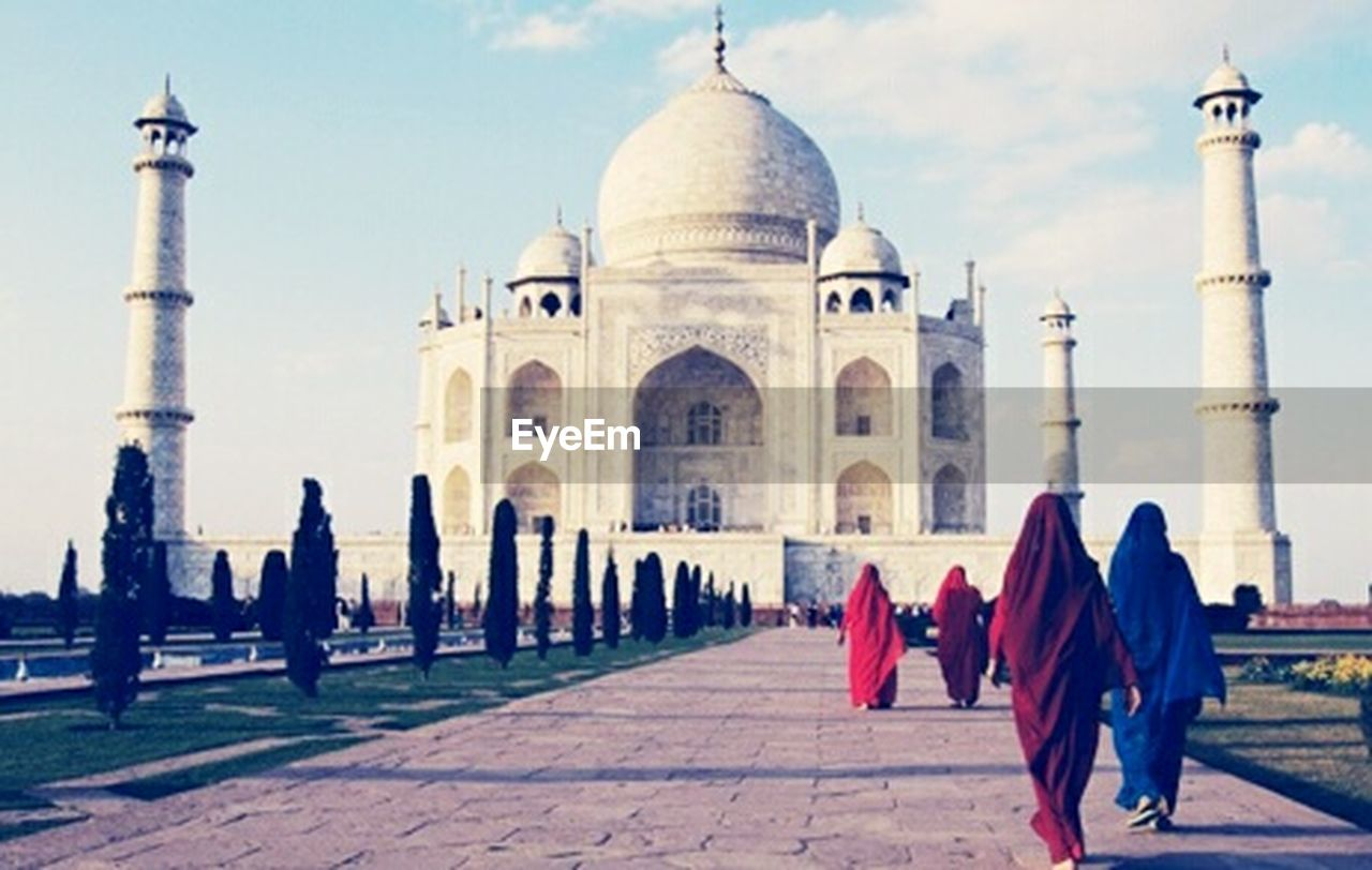 architecture, history, travel destinations, tourism, built structure, cultures, dome, building exterior, religion, large group of people, travel, outdoors, spirituality, monument, day, ancient, men, women, adult, sky, red, full length, people, adults only, vacations, real people, ancient civilization, city