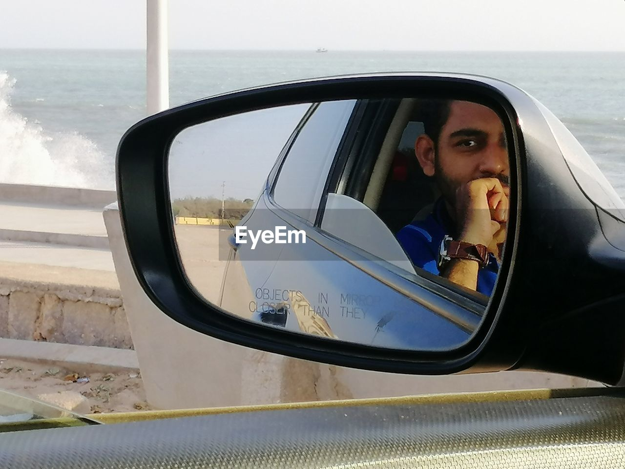 PORTRAIT OF MAN WITH REFLECTION ON MIRROR