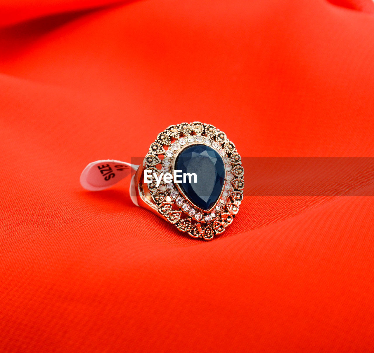jewelry, single object, ring, no people, luxury, indoors, red, studio shot, precious gem, diamond ring, close-up, day
