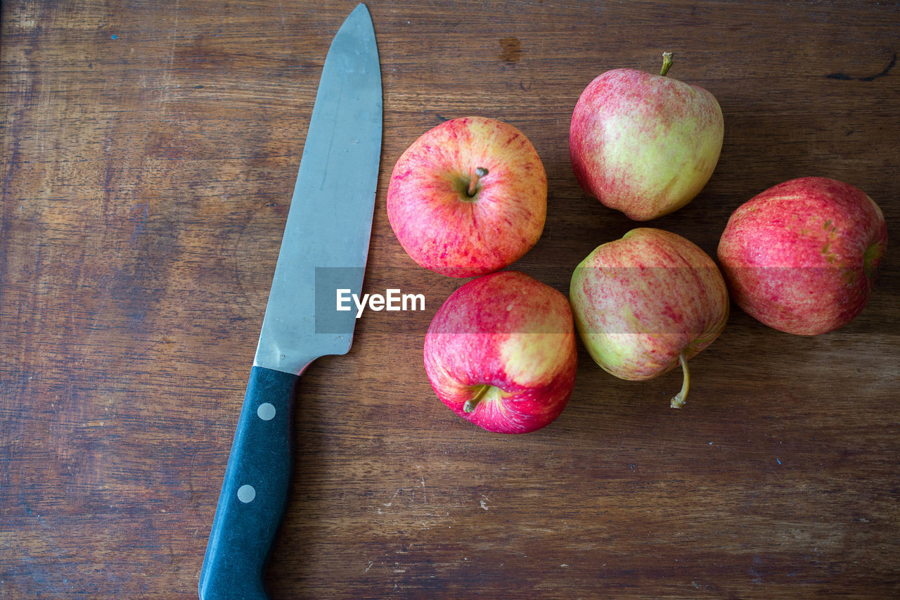 High angle view of apples on cutting board