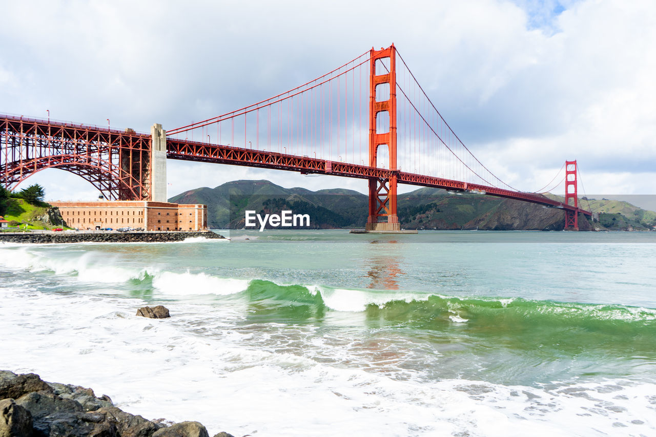 water, bridge, connection, built structure, bridge - man made structure, architecture, sky, transportation, nature, travel destinations, cloud - sky, engineering, suspension bridge, day, tourism, travel, city, bay of water, bay, outdoors