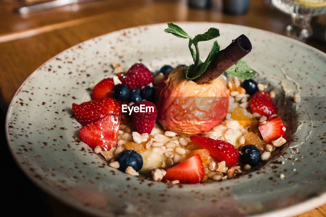 berry fruit, food, food and drink, fruit, healthy eating, strawberry, freshness, wellbeing, indoors, close-up, ready-to-eat, meal, blueberry, breakfast, bowl, raspberry, still life, breakfast cereal, table, no people, temptation, yogurt, mint leaf - culinary