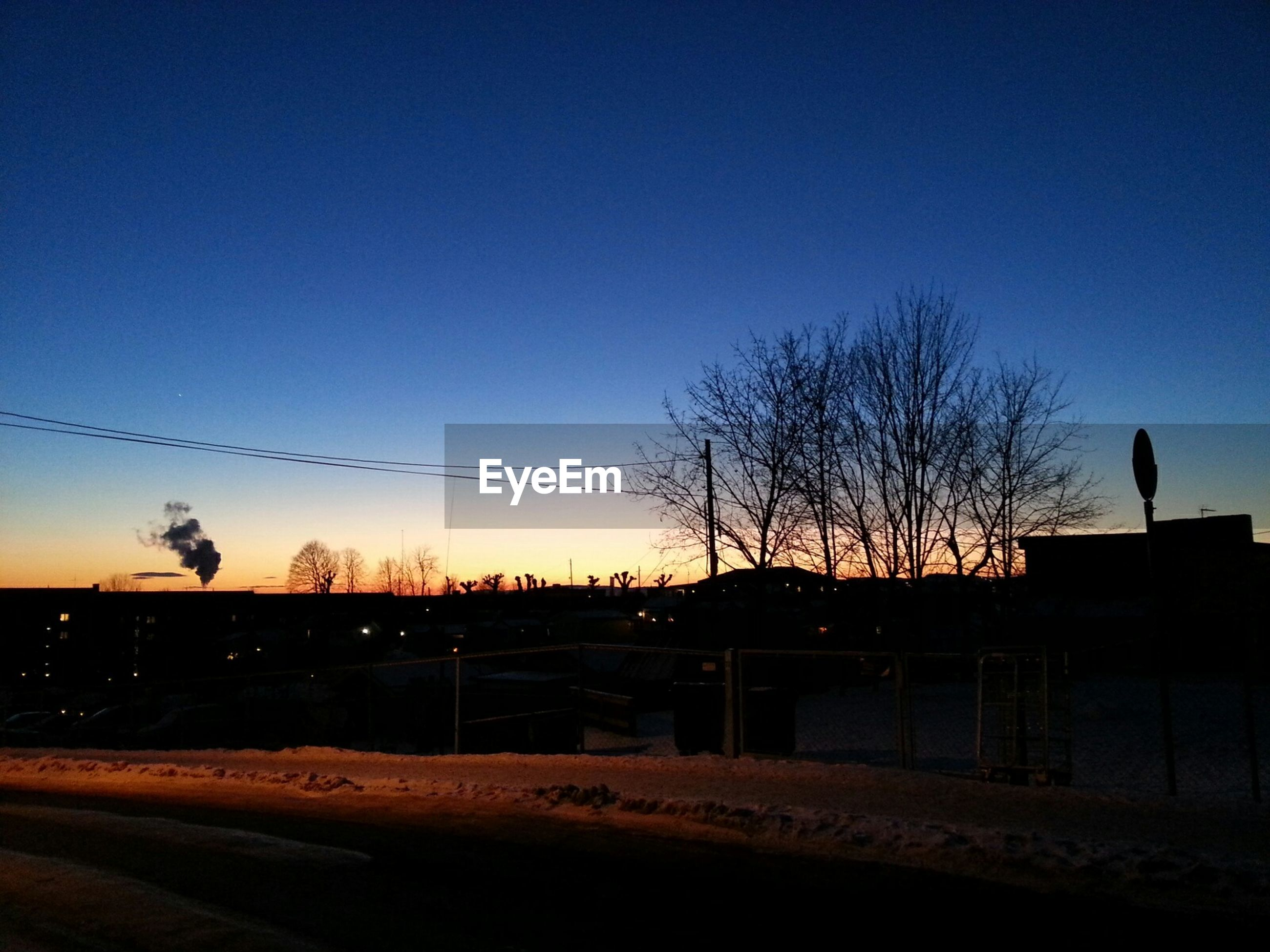 clear sky, silhouette, bare tree, sunset, copy space, tree, landscape, blue, tranquil scene, tranquility, road, dusk, nature, scenics, sky, transportation, field, fence, outdoors, no people