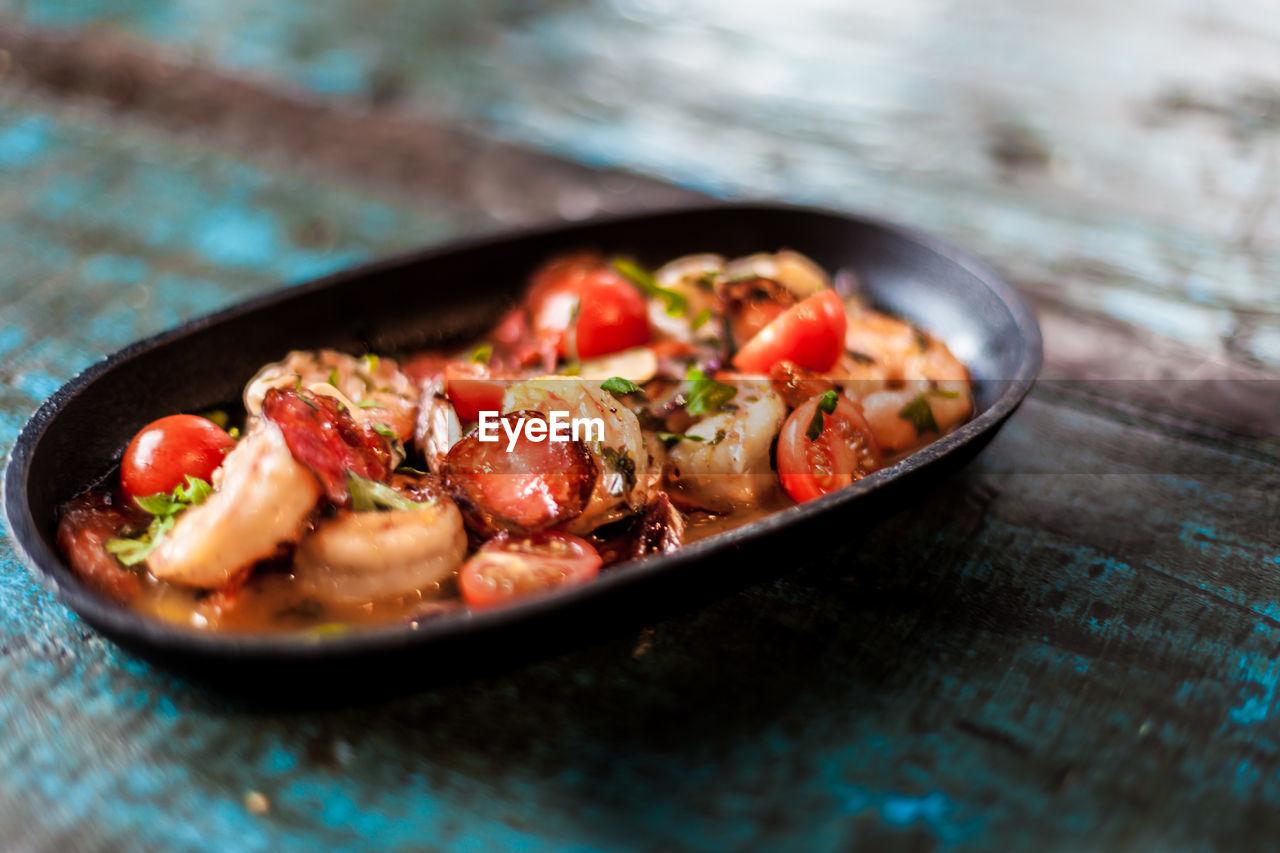 Close-up of shrimp tomato tapas dish