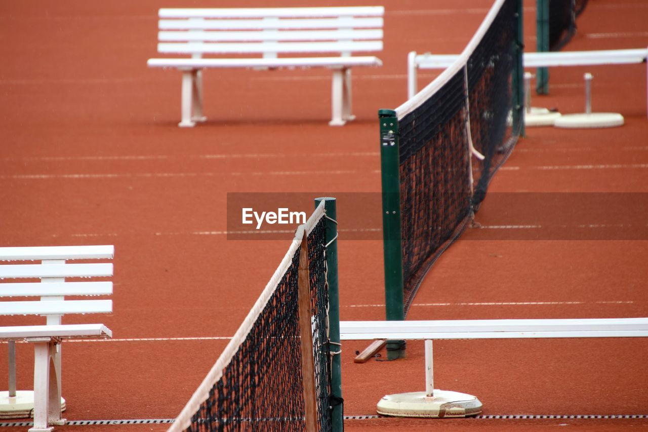 High angle view of empty seats on tennis court