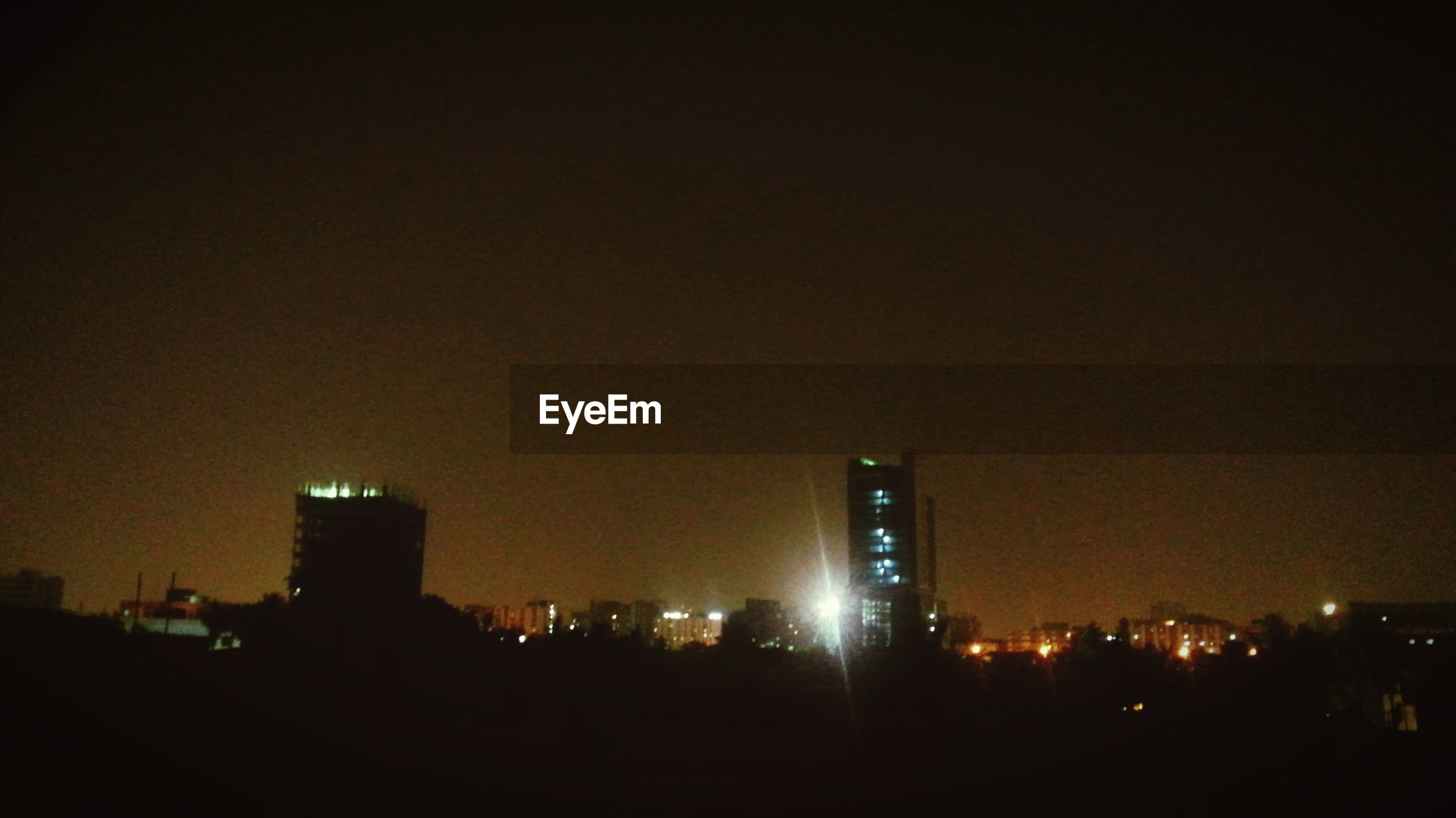 night, illuminated, building exterior, architecture, built structure, city, copy space, cityscape, dark, clear sky, skyscraper, urban skyline, silhouette, sky, city life, building, modern, tower, outdoors, residential building