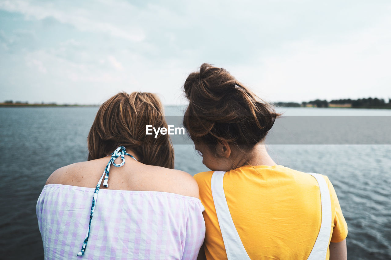 Adult Bonding Casual Clothing Child Emotion Hairstyle Headshot Leisure Activity Lifestyles Love Nature Outdoors Positive Emotion Real People Rear View Standing Togetherness Two People Waist Up Water Women