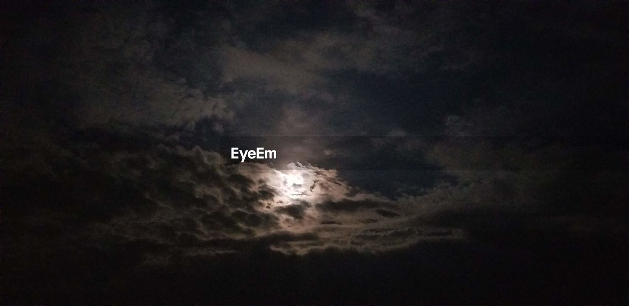 cloud - sky, sky, beauty in nature, scenics - nature, low angle view, night, storm, nature, tranquility, tranquil scene, no people, storm cloud, overcast, outdoors, cloudscape, dark, power in nature, dramatic sky, idyllic, moonlight, meteorology, ominous, planetary moon