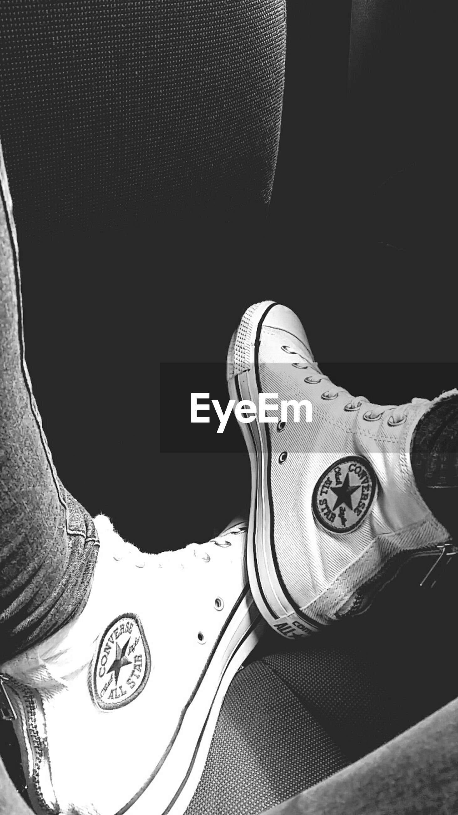 indoors, lifestyles, person, low section, leisure activity, men, part of, close-up, shoe, personal perspective, jeans, unrecognizable person, fashion, casual clothing, copy space