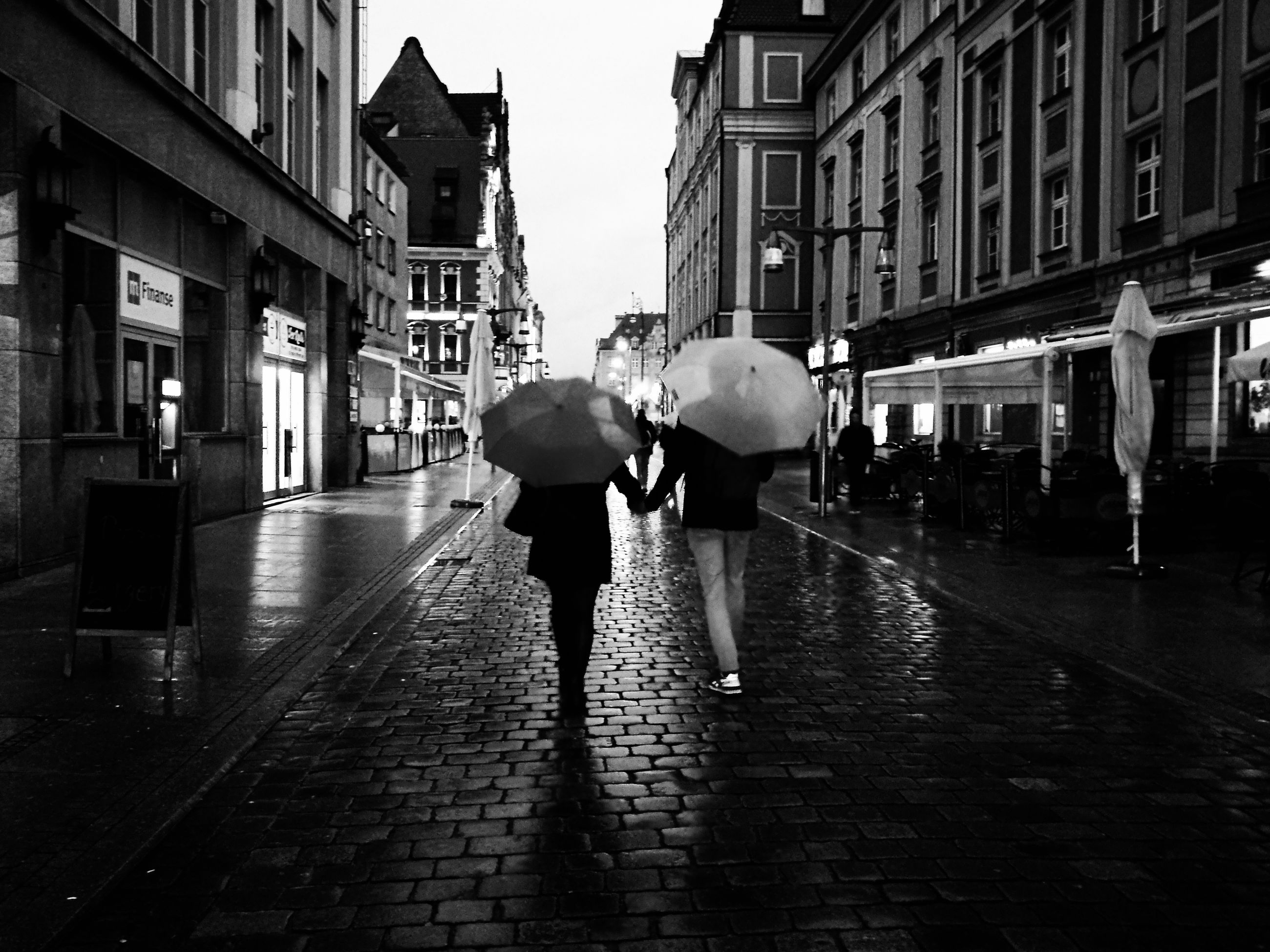 architecture, building exterior, built structure, wet, street, rain, walking, full length, men, city, rear view, season, city street, water, person, day, city life, footpath, the way forward, sky