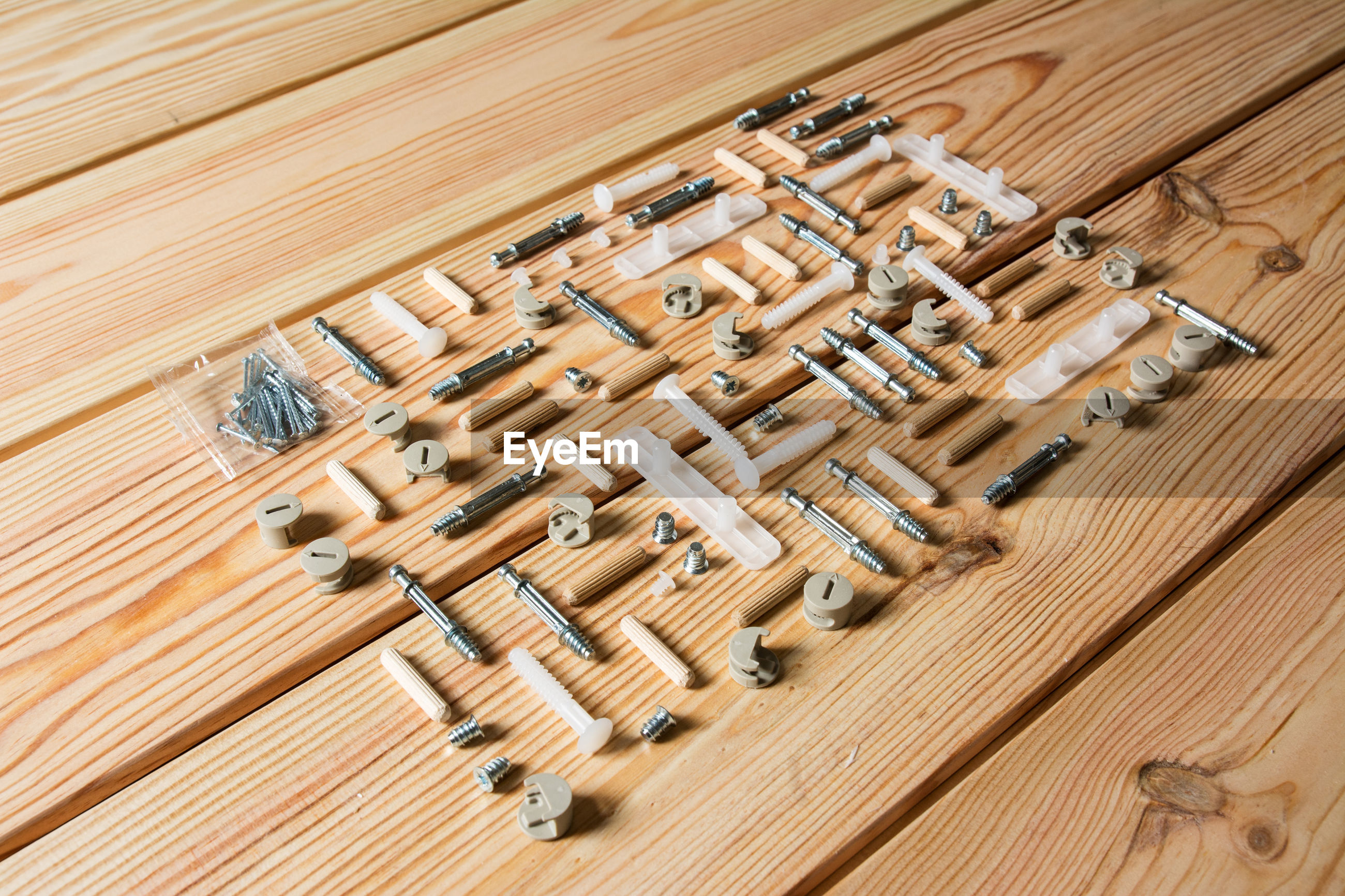 High angle view of various work tools arranged on wooden table