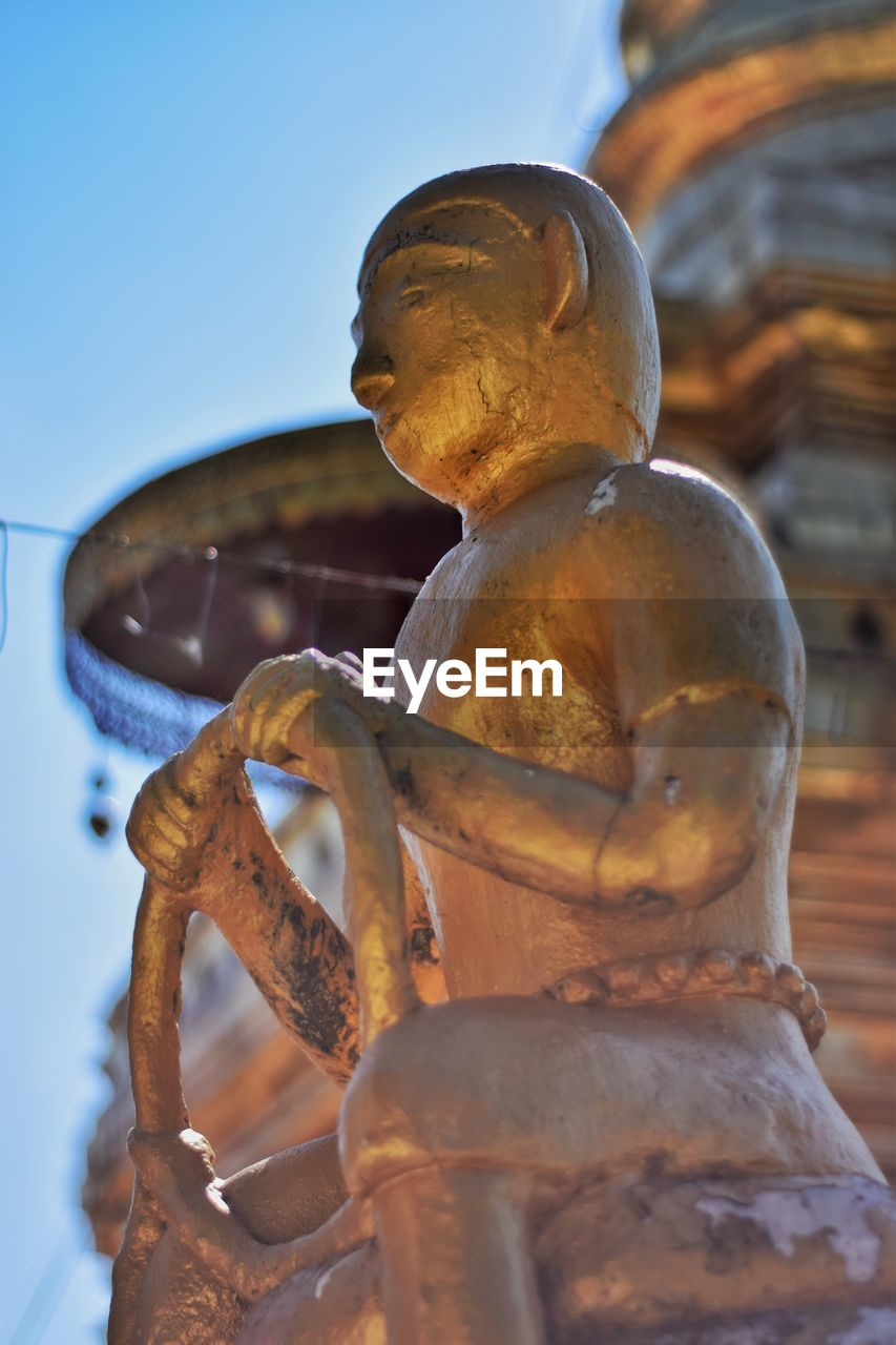 sculpture, art and craft, statue, representation, human representation, belief, spirituality, creativity, religion, no people, male likeness, architecture, place of worship, sky, built structure, craft, close-up, focus on foreground, idol