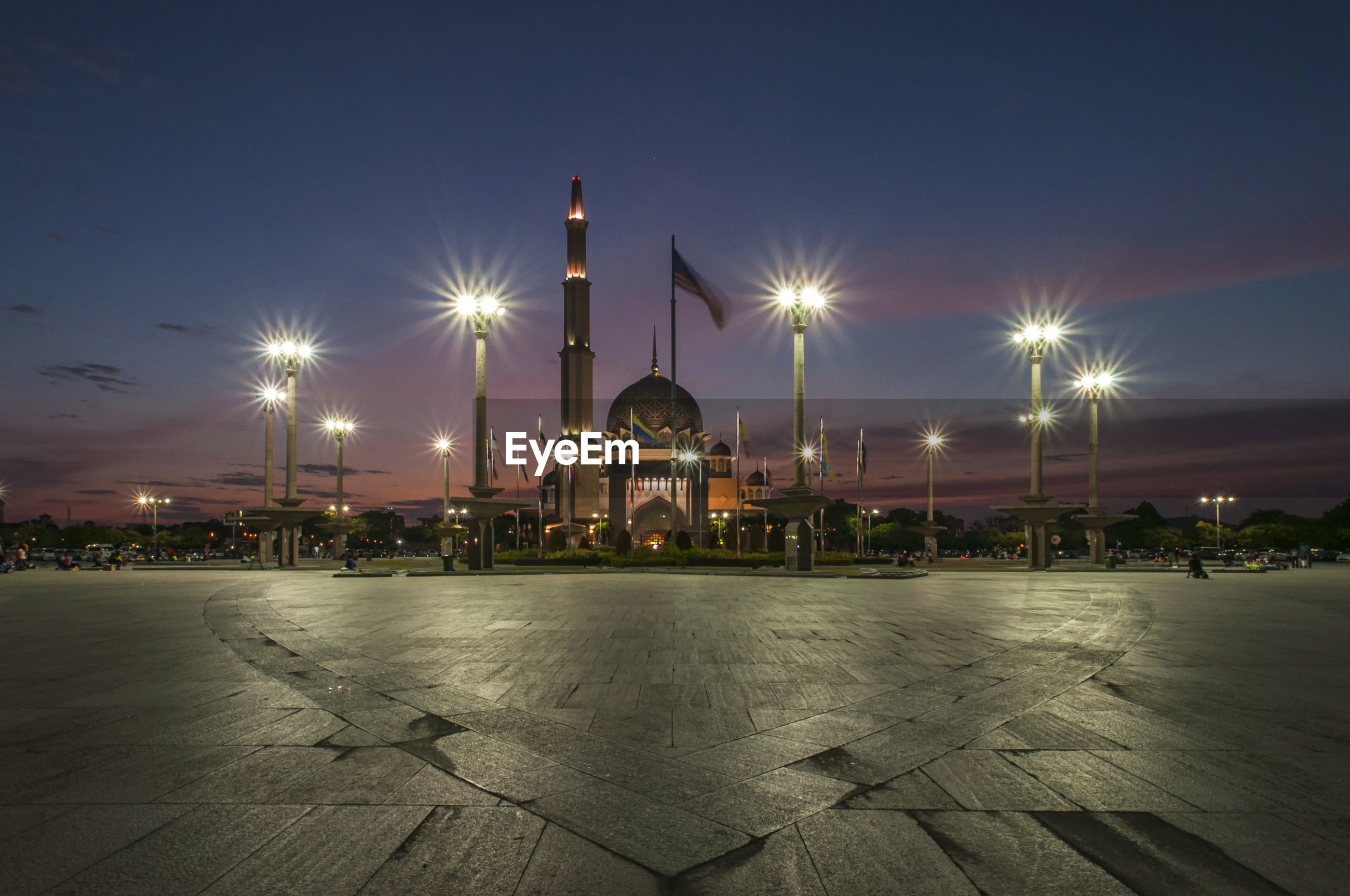 Illuminated street lights outside mosque at night