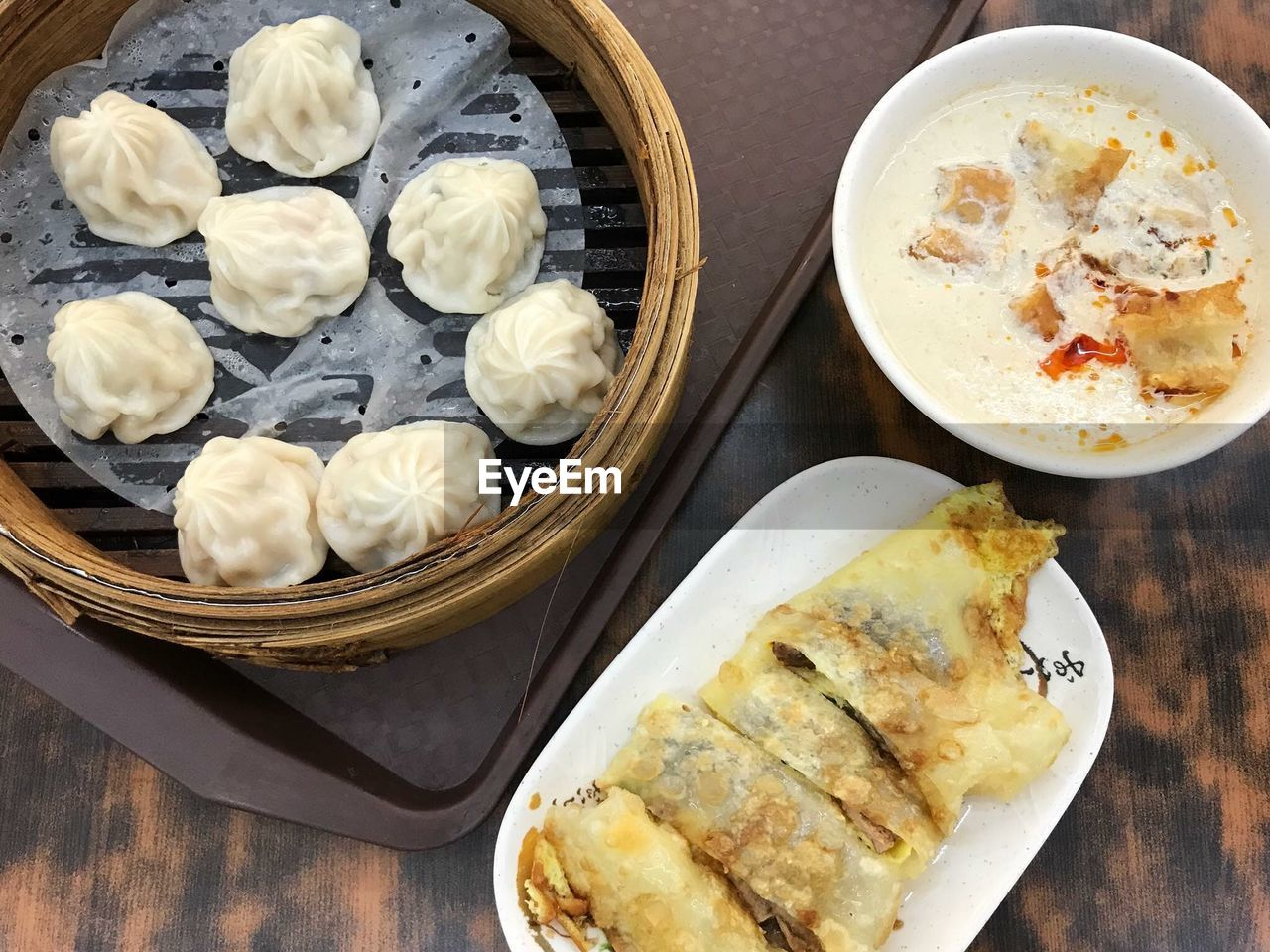 food, food and drink, freshness, ready-to-eat, table, healthy eating, wellbeing, still life, dumpling, high angle view, indoors, plate, no people, asian food, bowl, serving size, container, bread, chinese dumpling, chinese food, meal, temptation, tray, breakfast, steamed