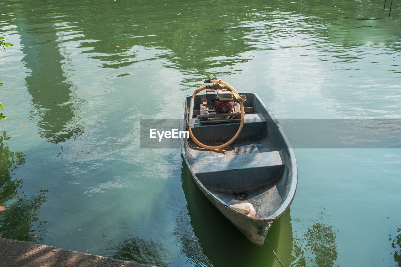 water, nautical vessel, transportation, mode of transportation, moored, day, reflection, high angle view, nature, lake, waterfront, outdoors, no people, travel, gondola - traditional boat, sunlight, tranquility, rowboat