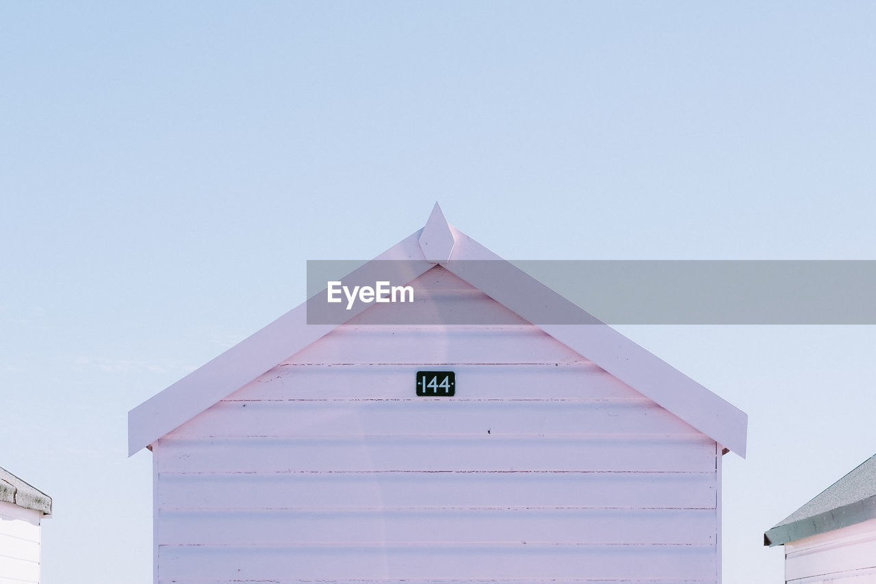 Low angle view of beach hut against sky