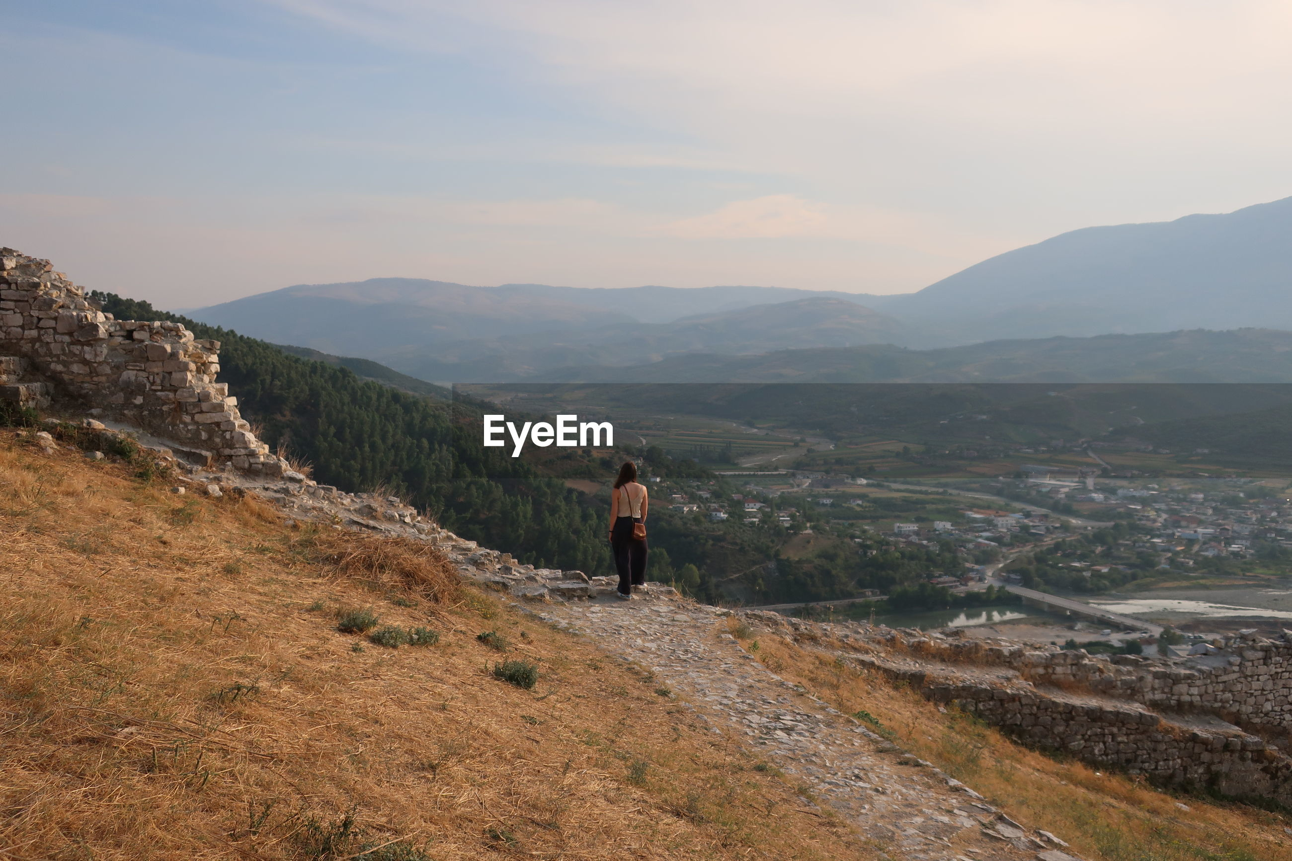 Woman standing on mountain against sky in berat, albania