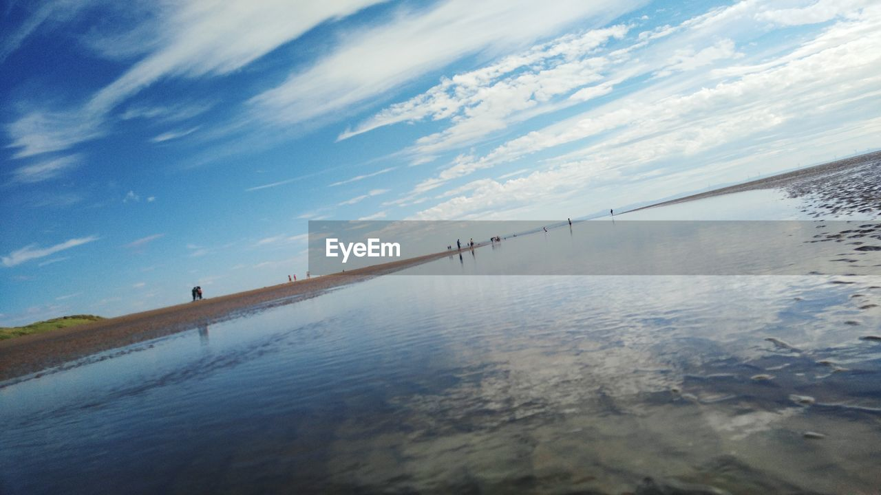 water, sky, tranquil scene, tranquility, cloud - sky, nature, scenics, outdoors, sea, reflection, day, no people, beauty in nature, beach, horizon over water
