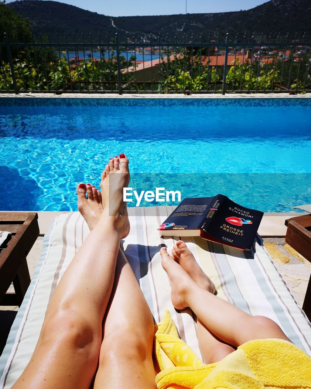 water, swimming pool, pool, low section, relaxation, barefoot, real people, human body part, leisure activity, human leg, lifestyles, one person, nature, adult, summer, lounge chair, poolside, women, day, body part, human foot, outdoors, nail