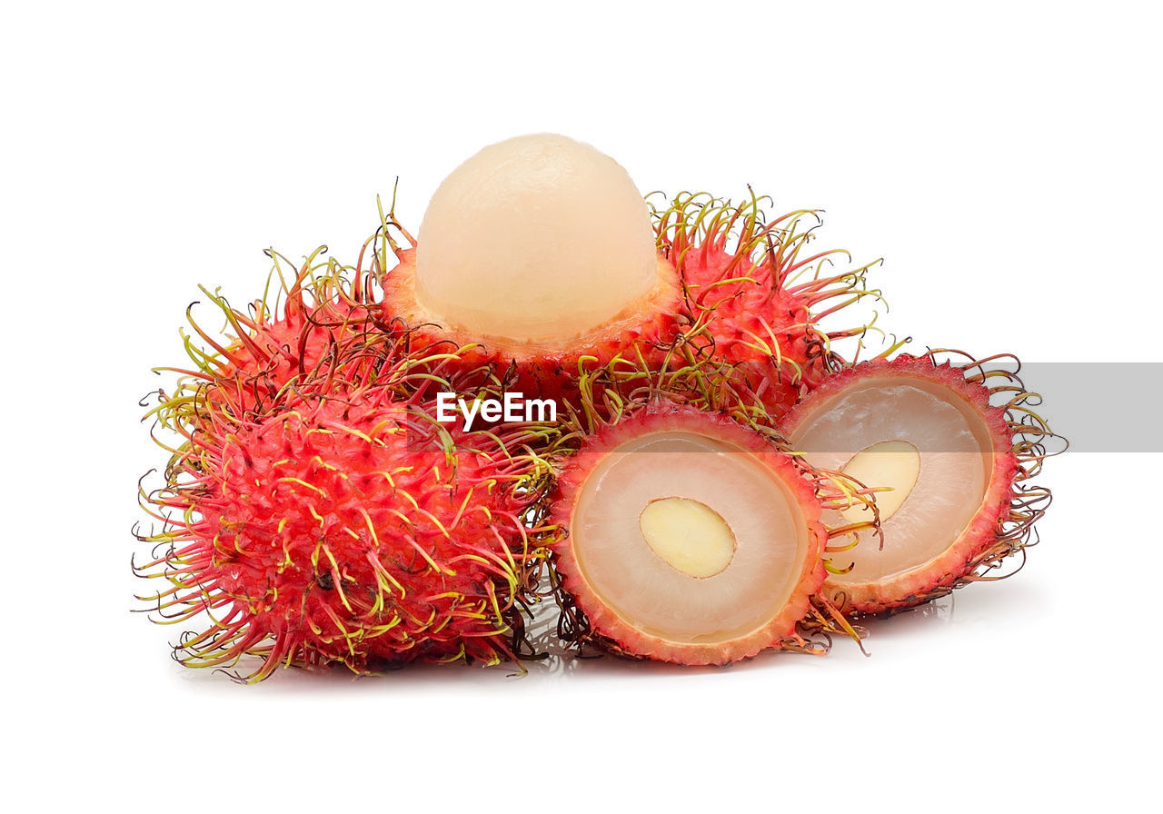 Close-up of rambutans against white background